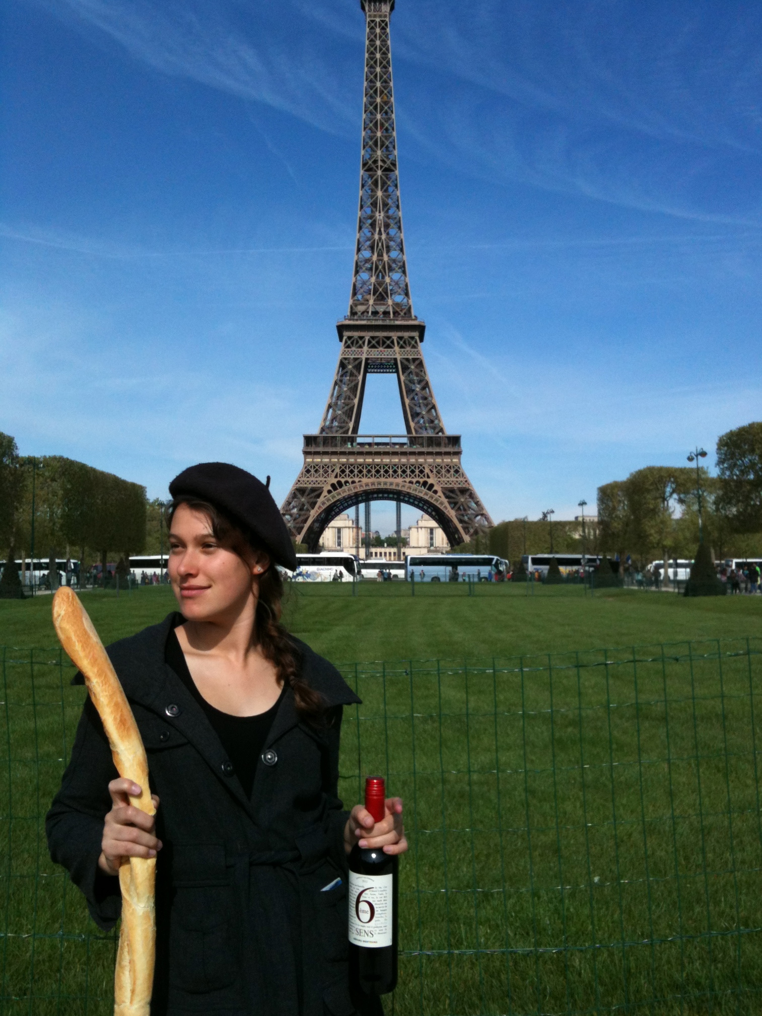 Me in front of the Eiffel Tower with a bottle of wine, a baguette and a beret