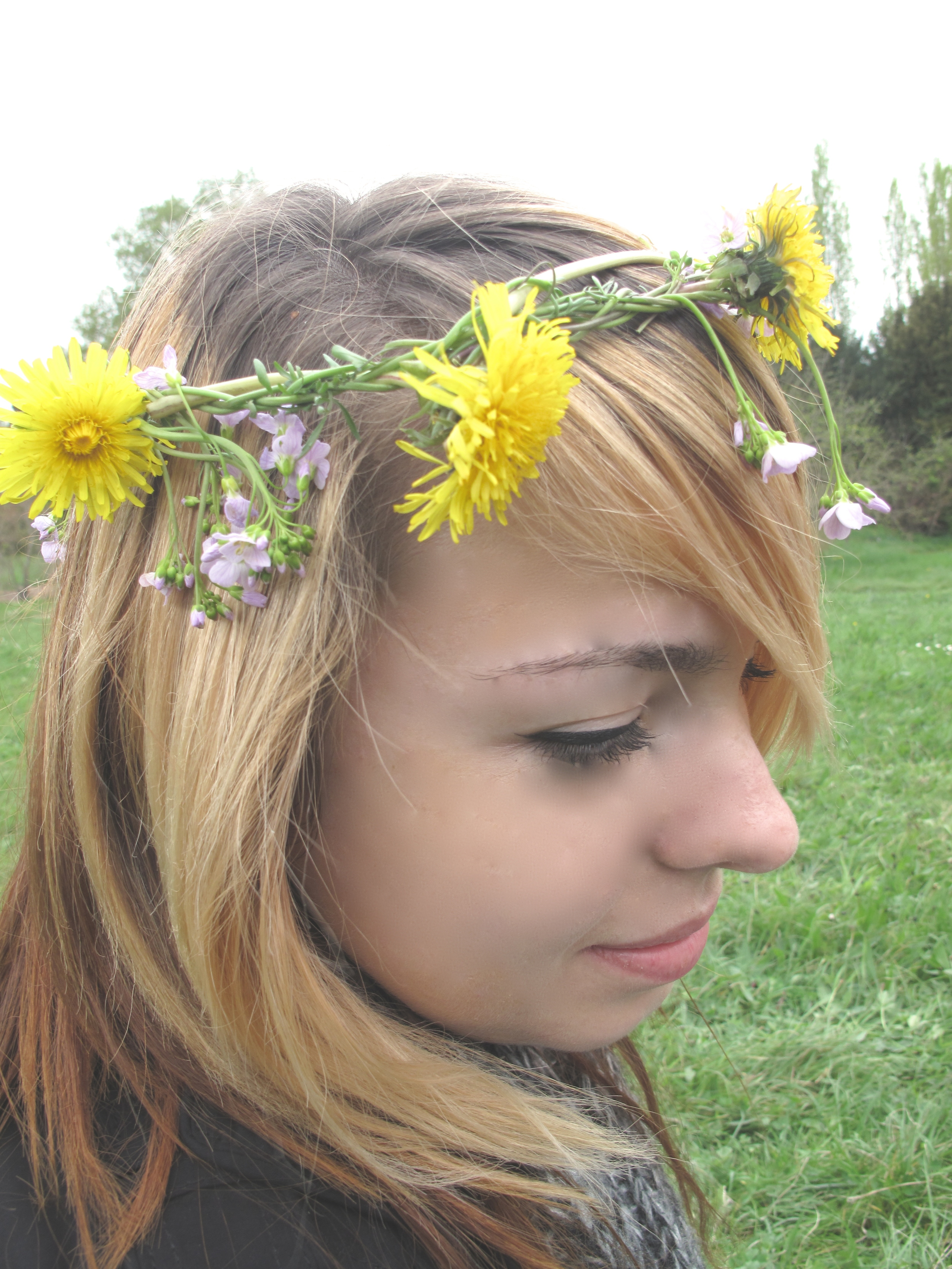 Rita with flowers in her hair on the grass at Versailles