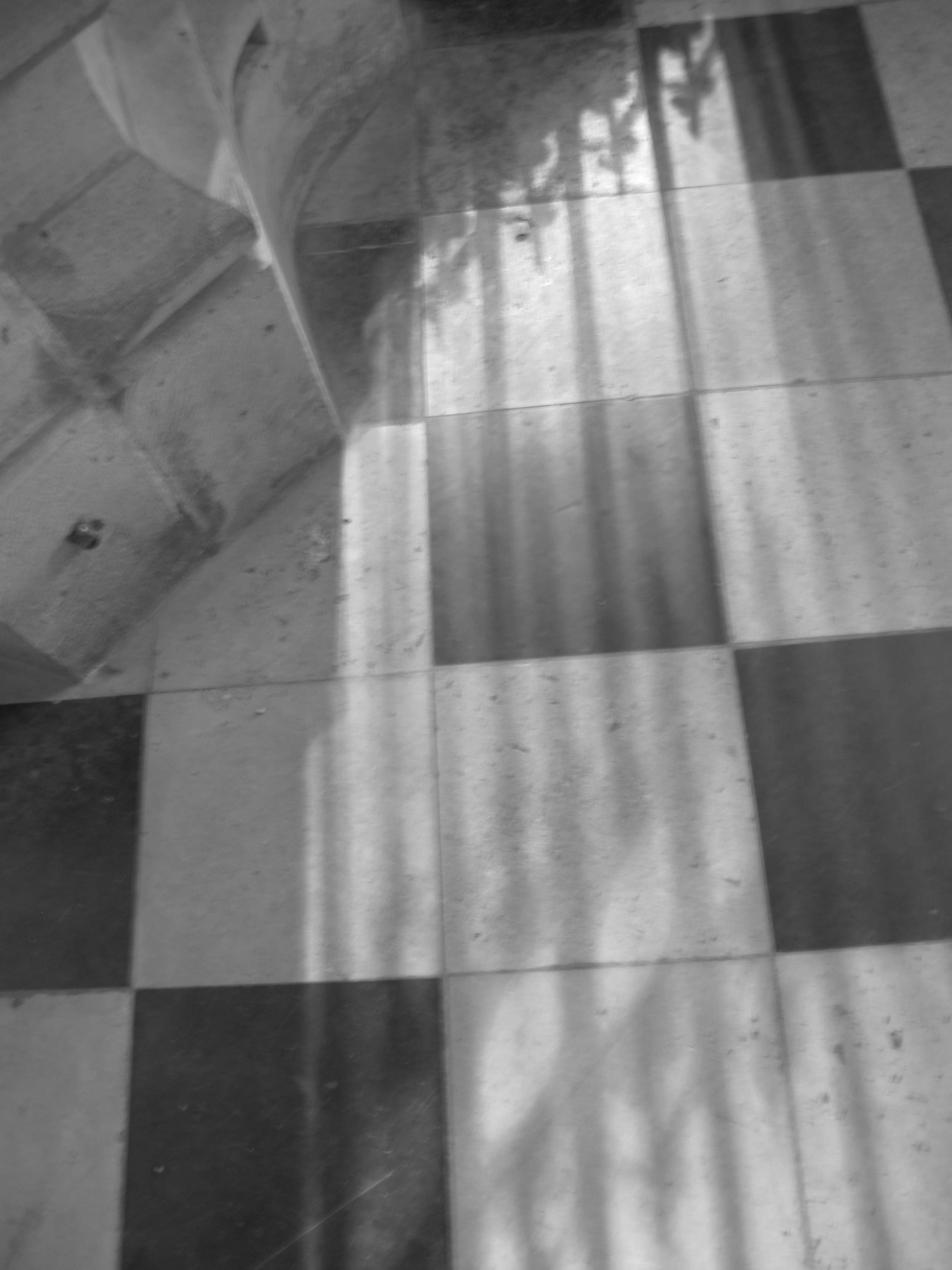 Shadow and light from the windows of Beauvais - shadows on the floor tiles