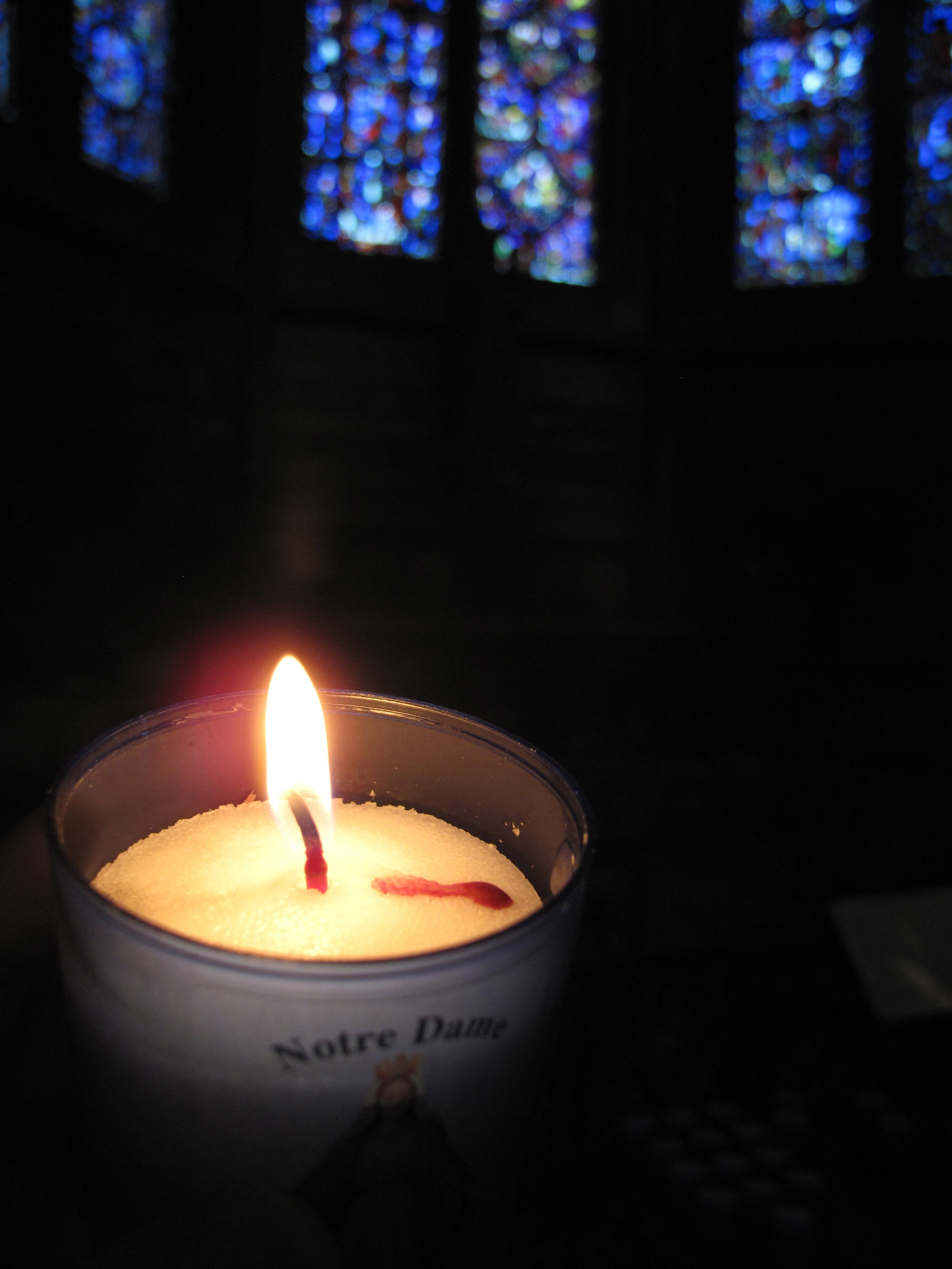 Lighting a candle in the dark of Beauvais cathedral