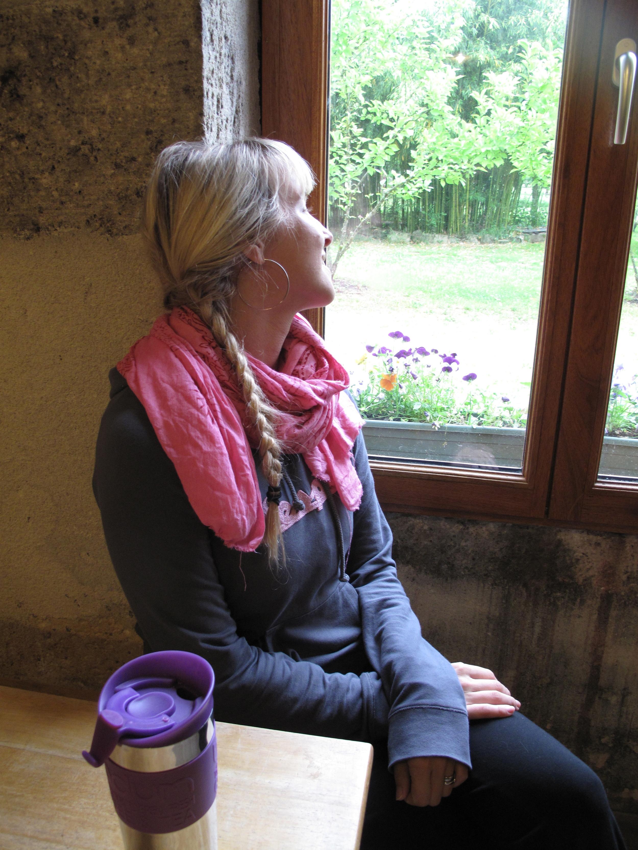 Elisabeth drinking tea by the window