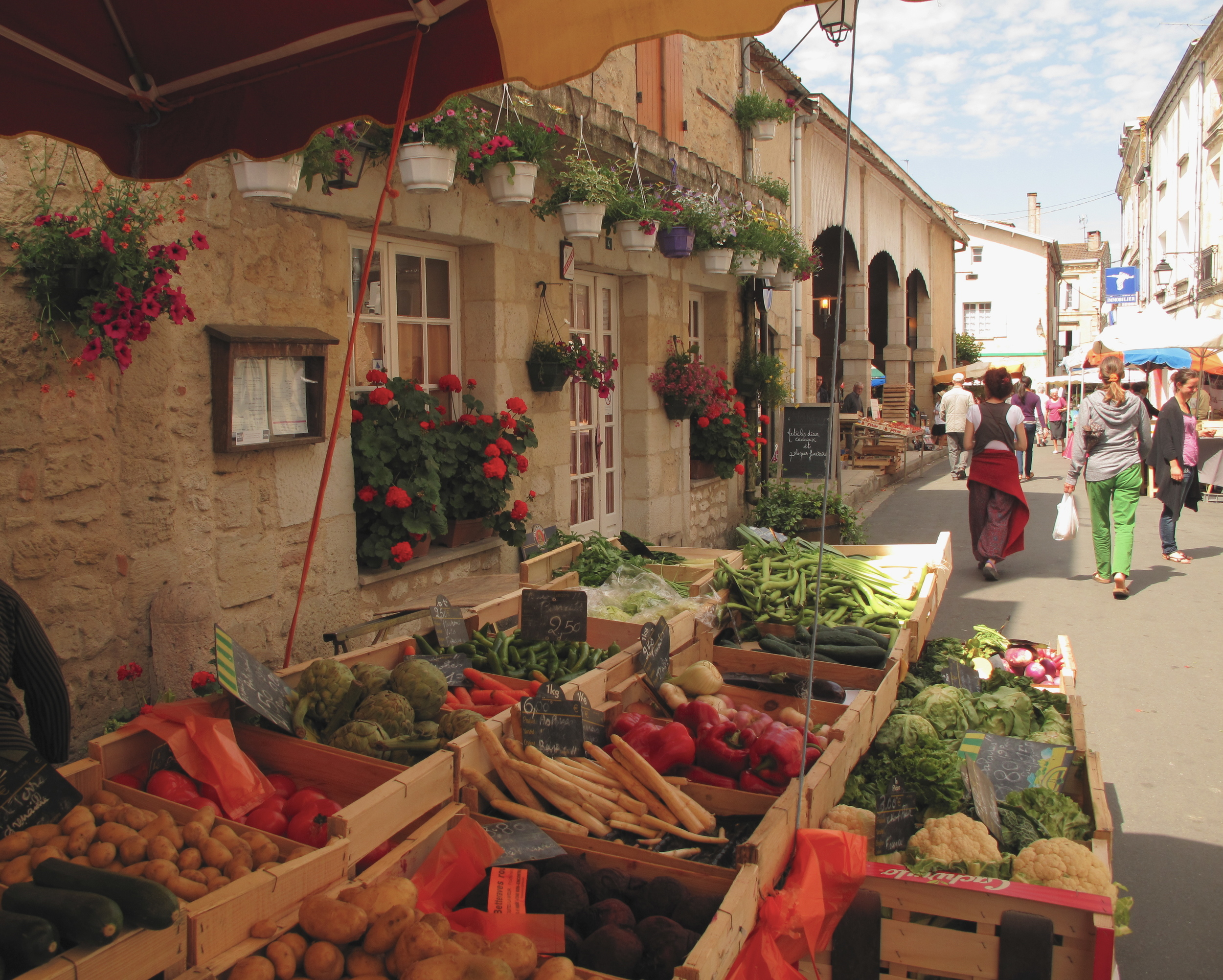 Market place in Duras - with spices, vegetables, garlic, olives, wine and truffles.
