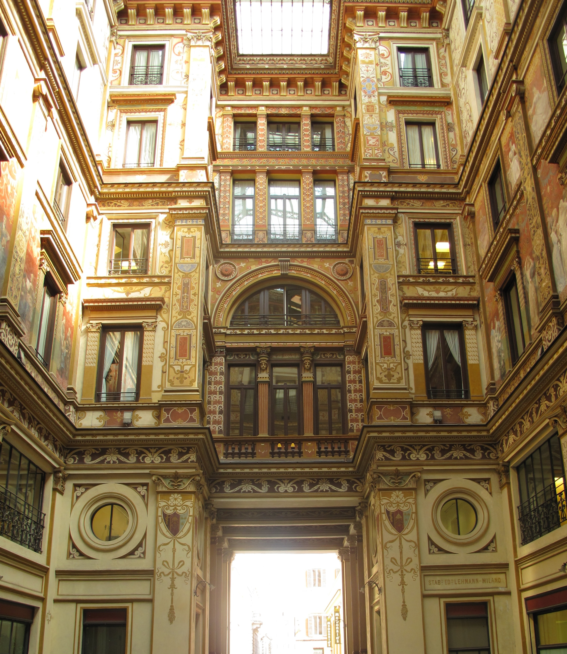 A beautifully painted interior courtyard in Rome