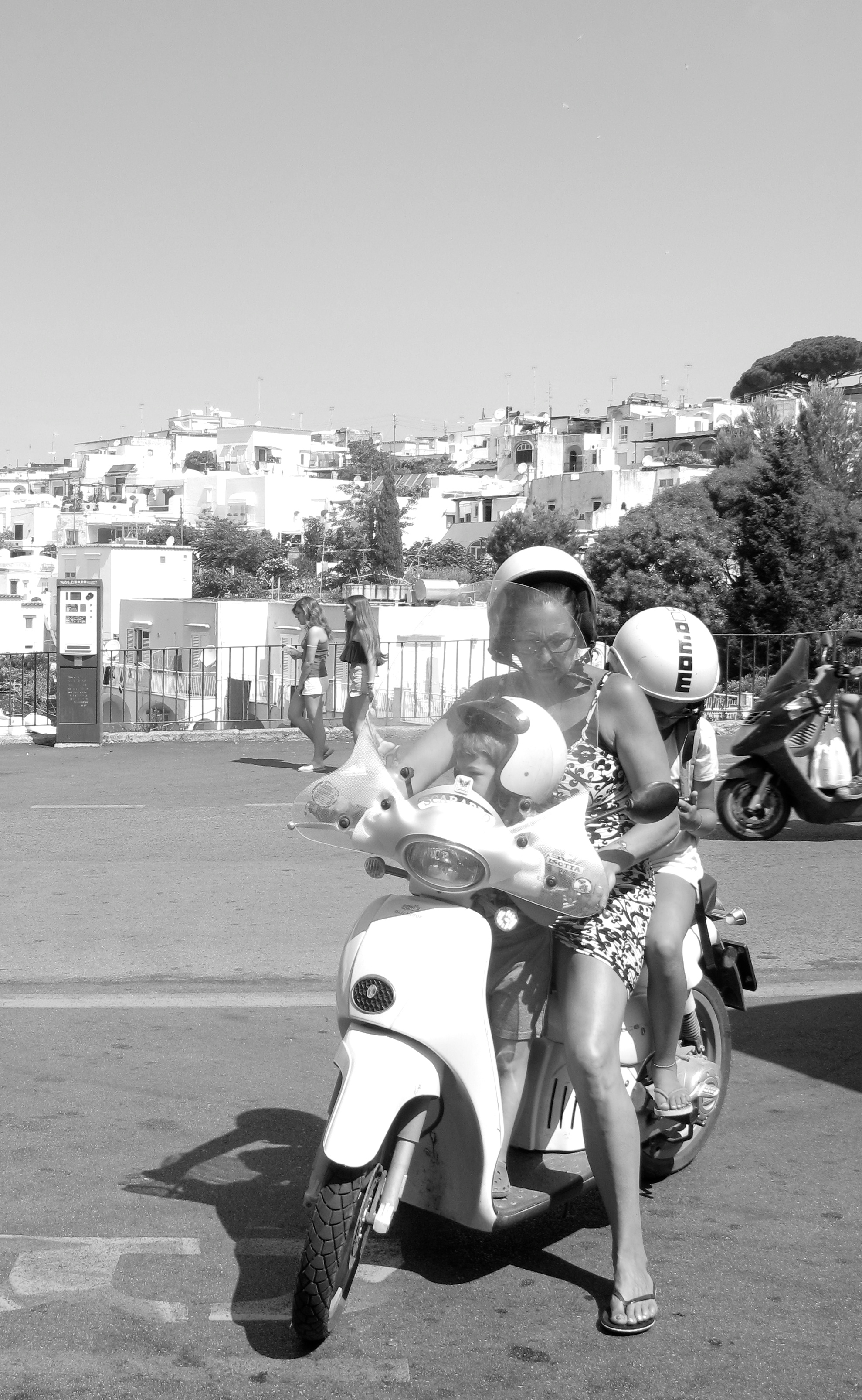 A mother and two children on a scooter - so Italian!
