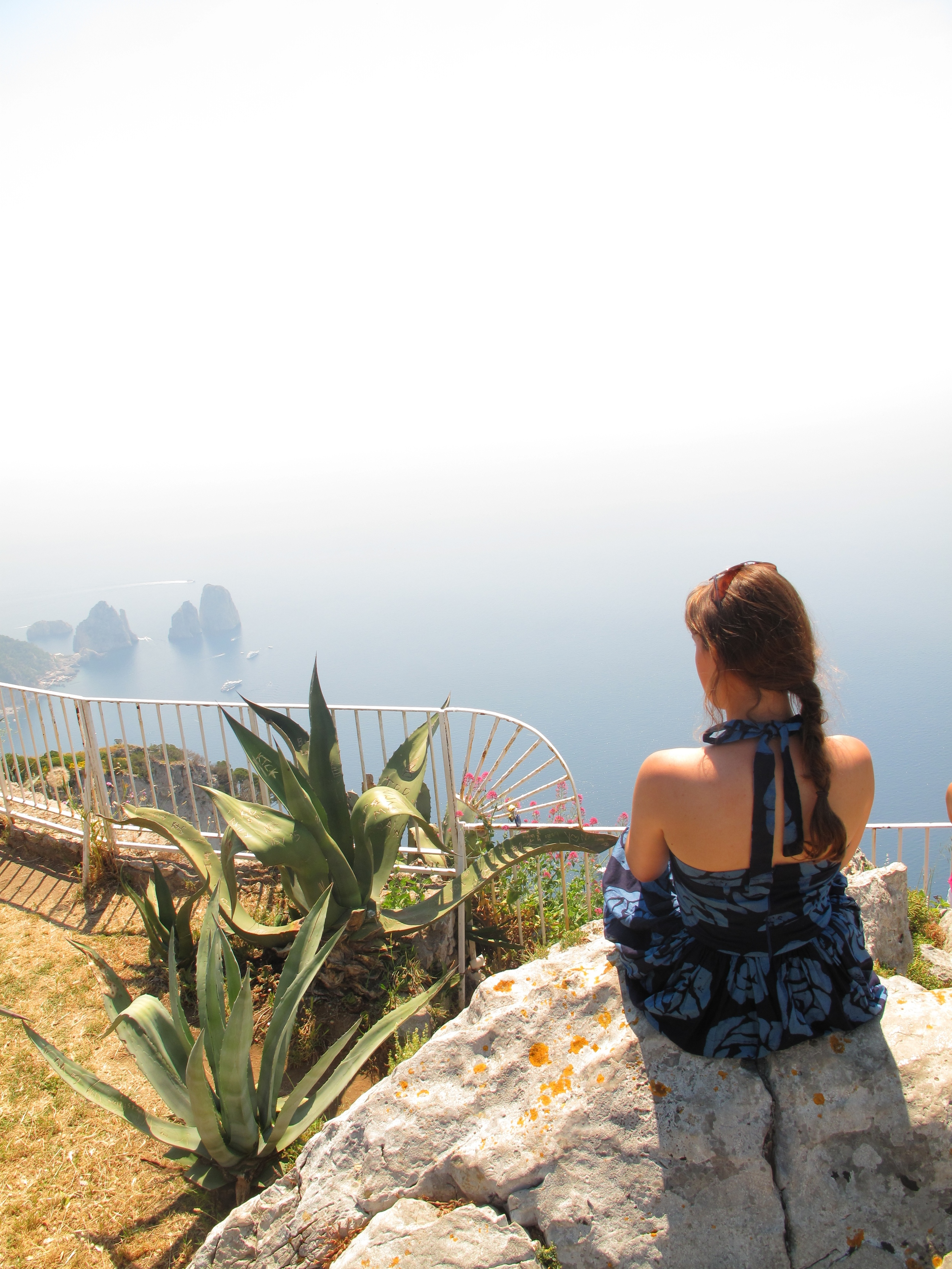 Sitting on a rock looking over the island of Capri