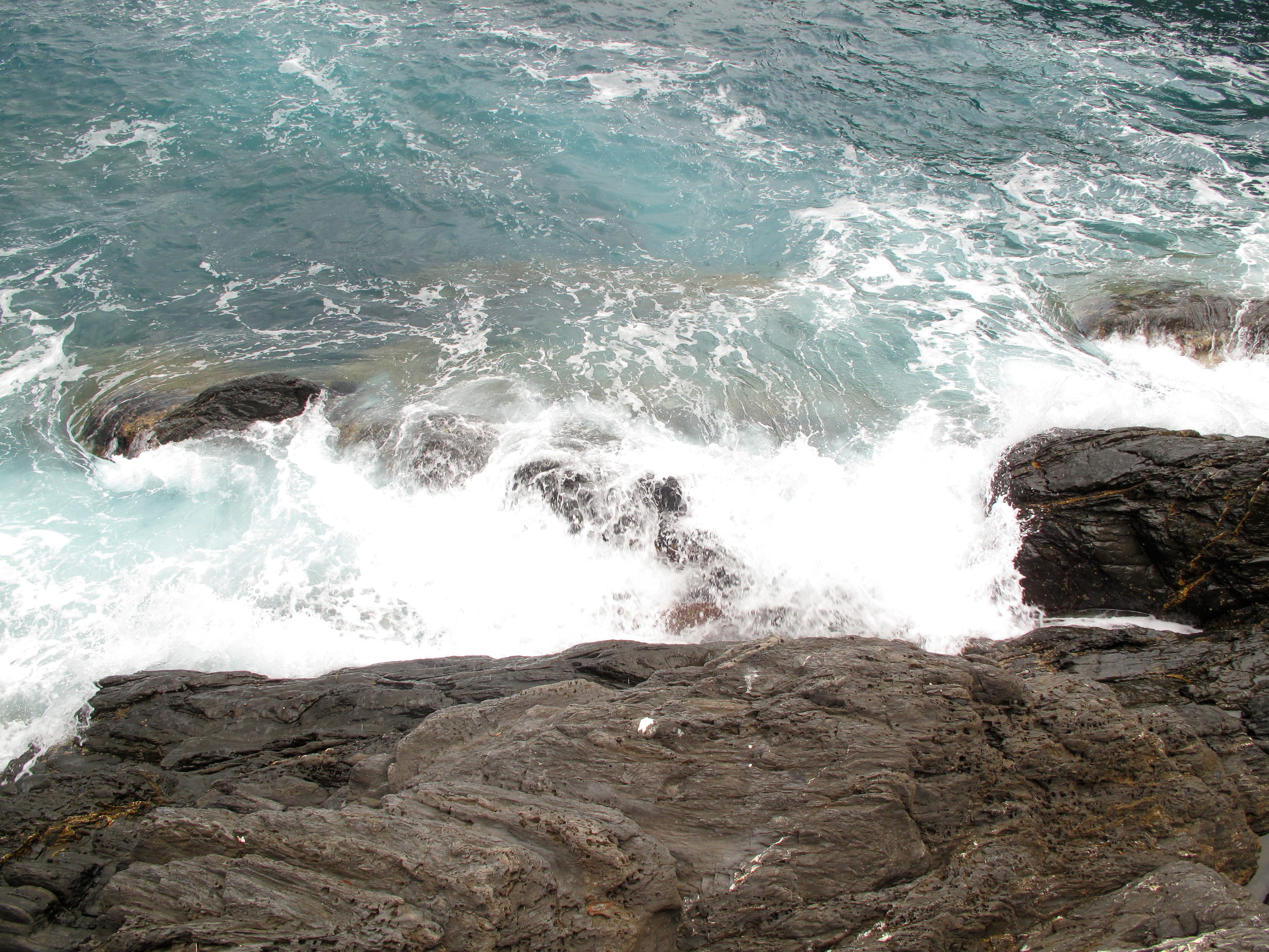 Waves over rocks on the coast of the Cinque Terre