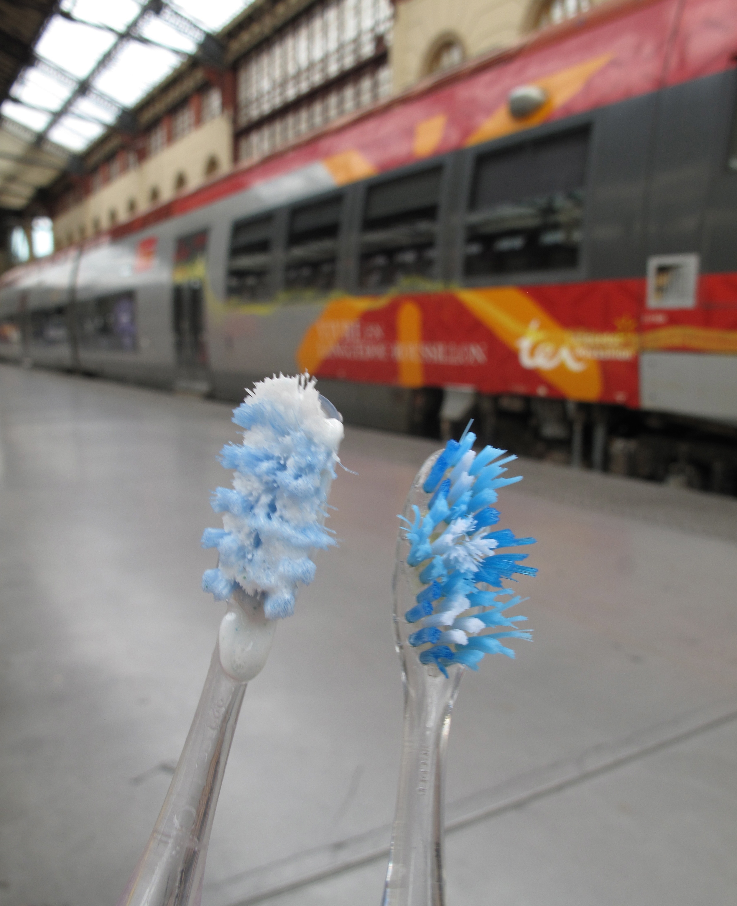 Brushing our teeth in Marseilles train station
