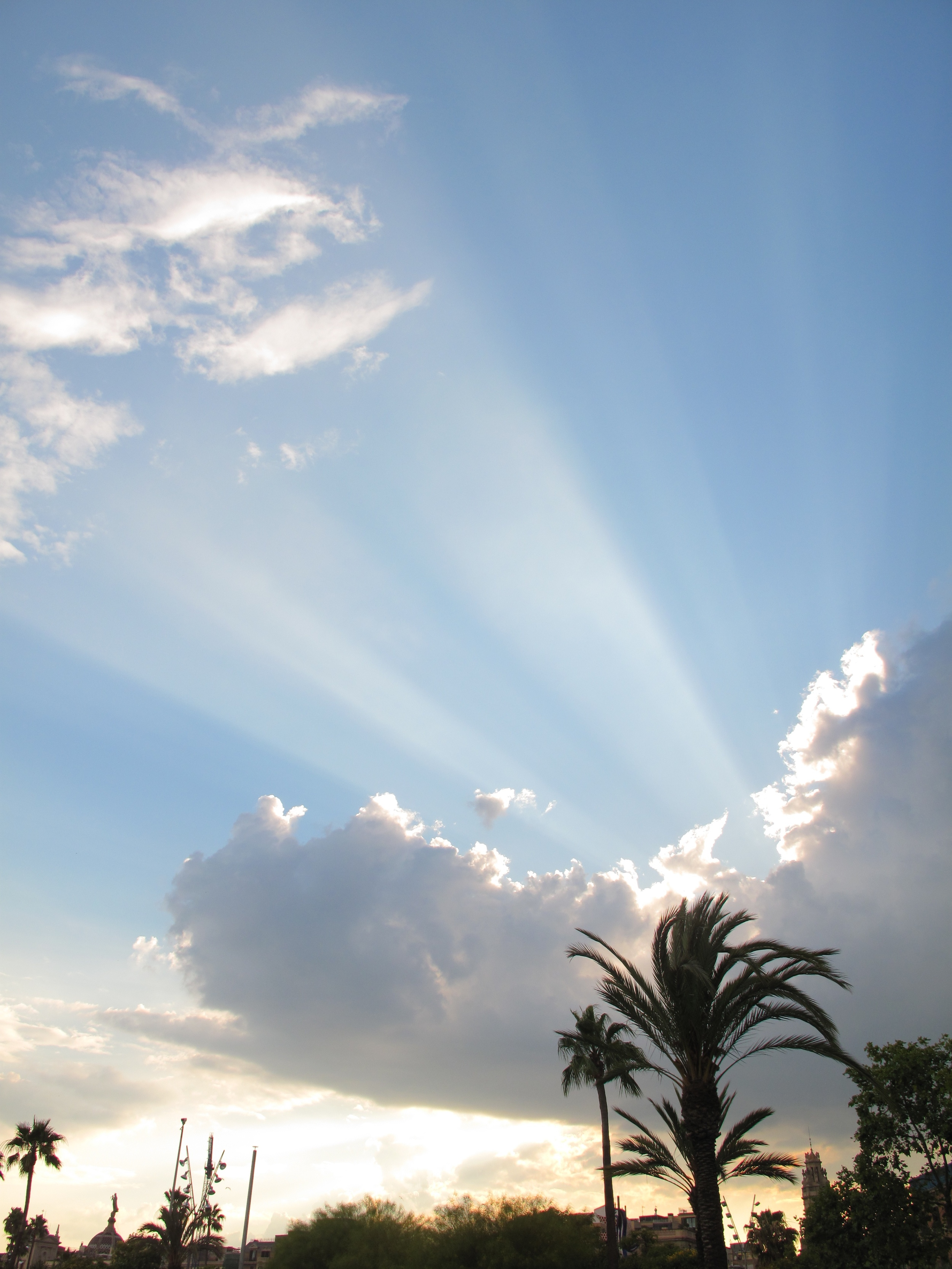 Sun rays over Barcelona at sunset