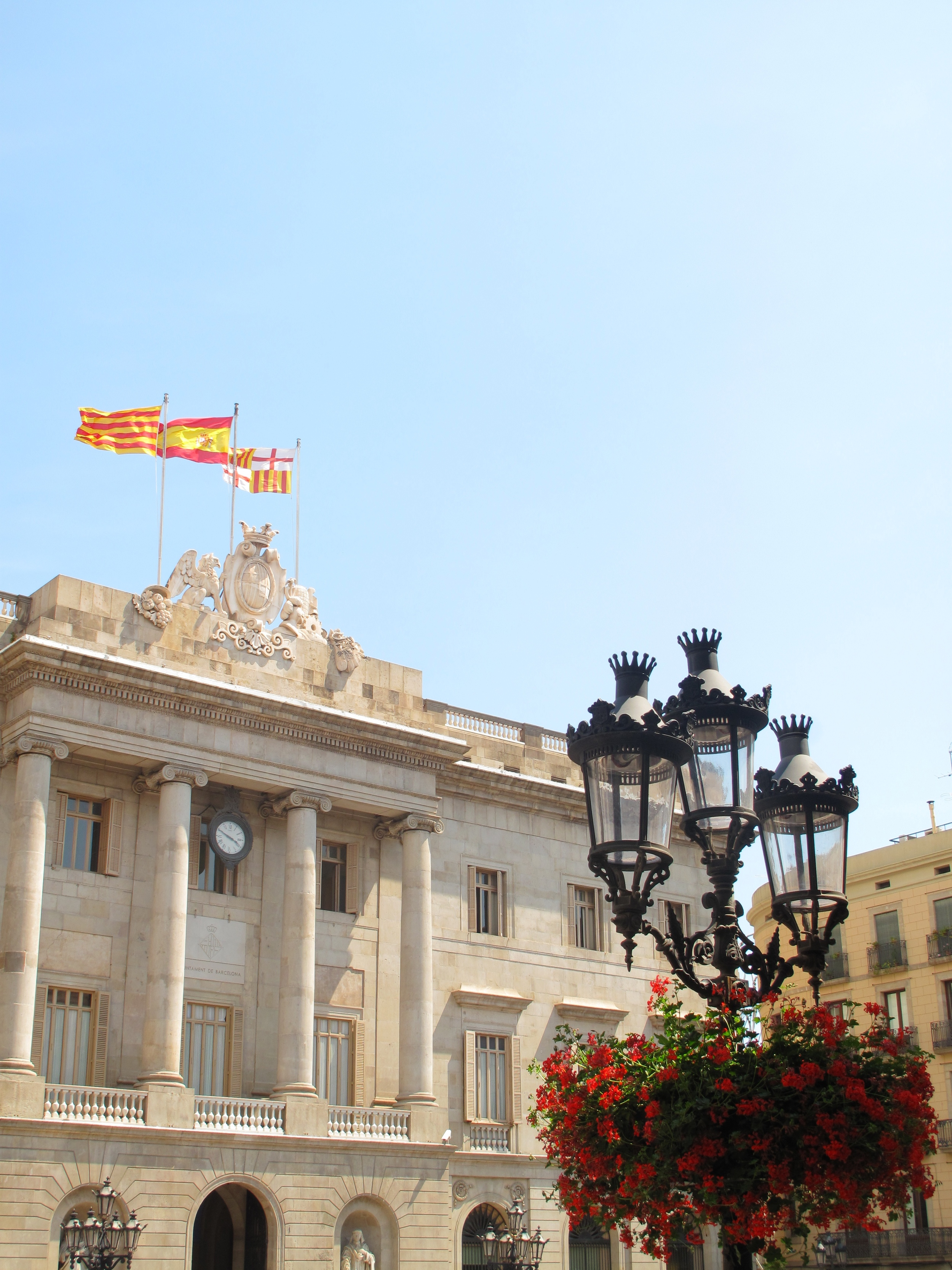 Buildings, flags and hanging flowers Barcelona