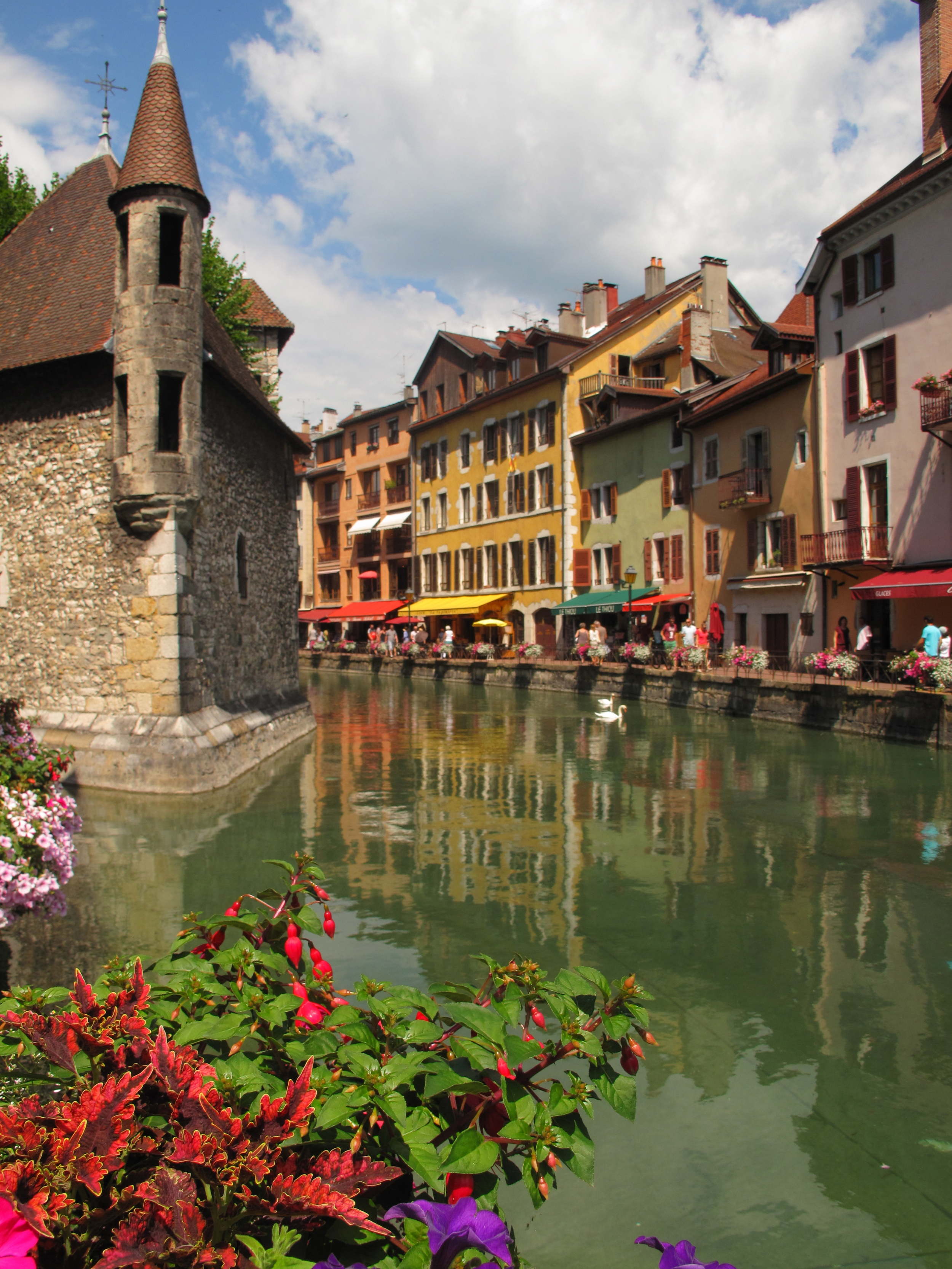Annecy's beautiful canals and old buildings in Annecy le Vieux - with flowers in the summer