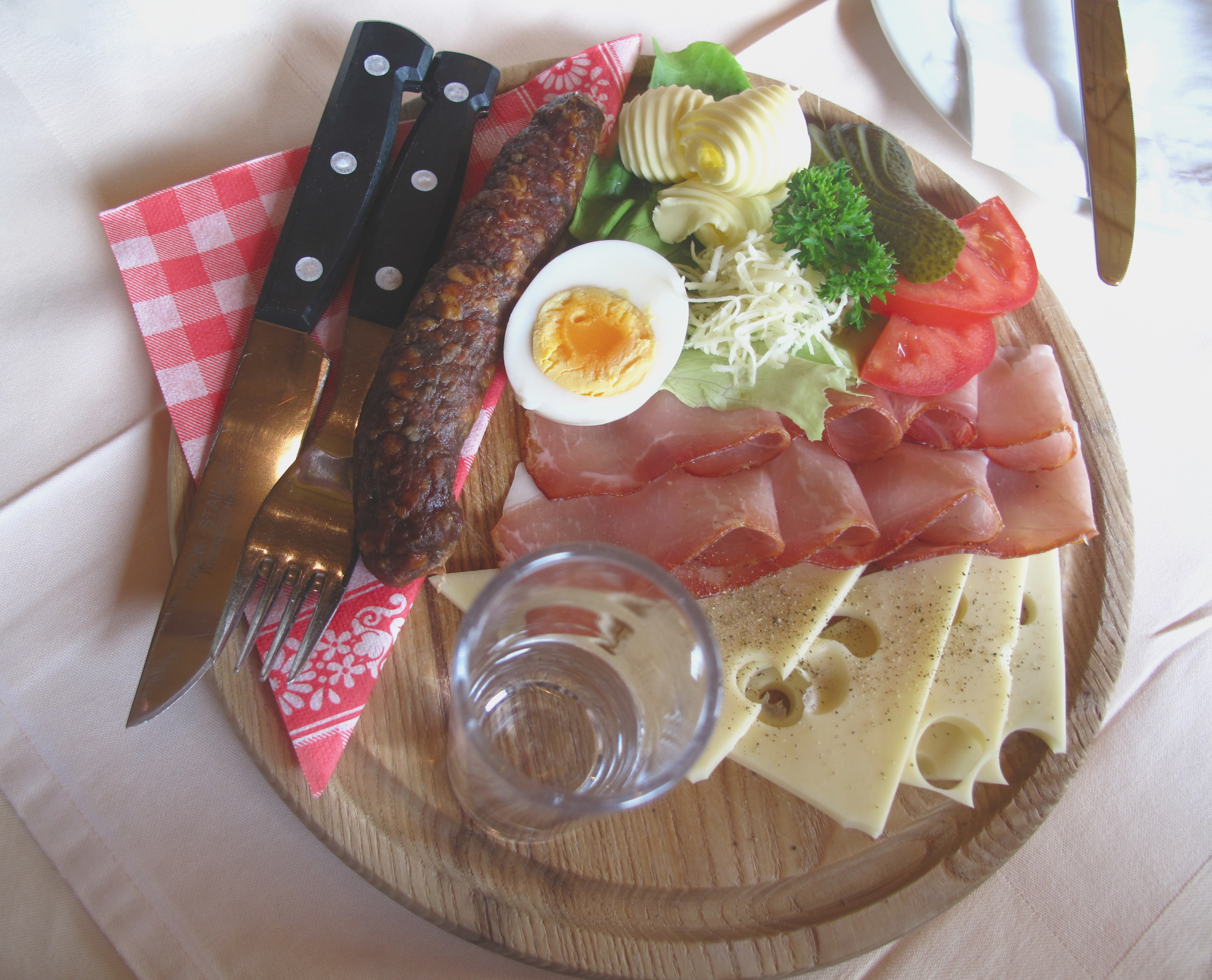 Platter of fresh Austrian produce - cheese, meat, sausage, eggs and butter.