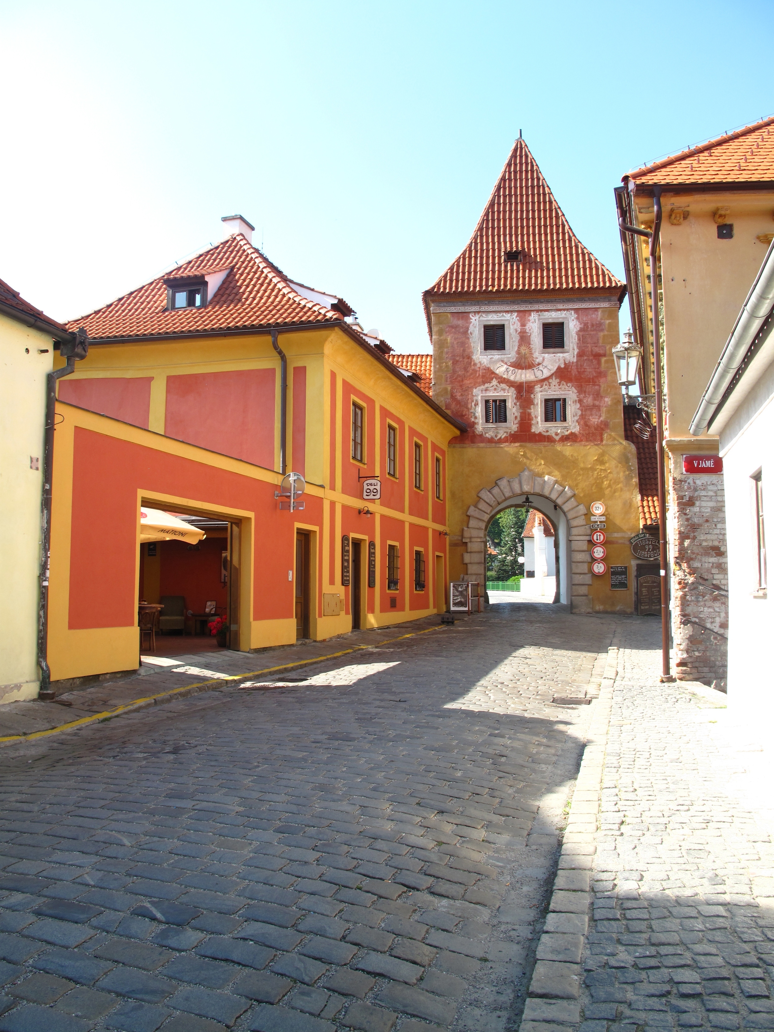 Cesky Krumlov arches for the road in the old town - orange buildings.