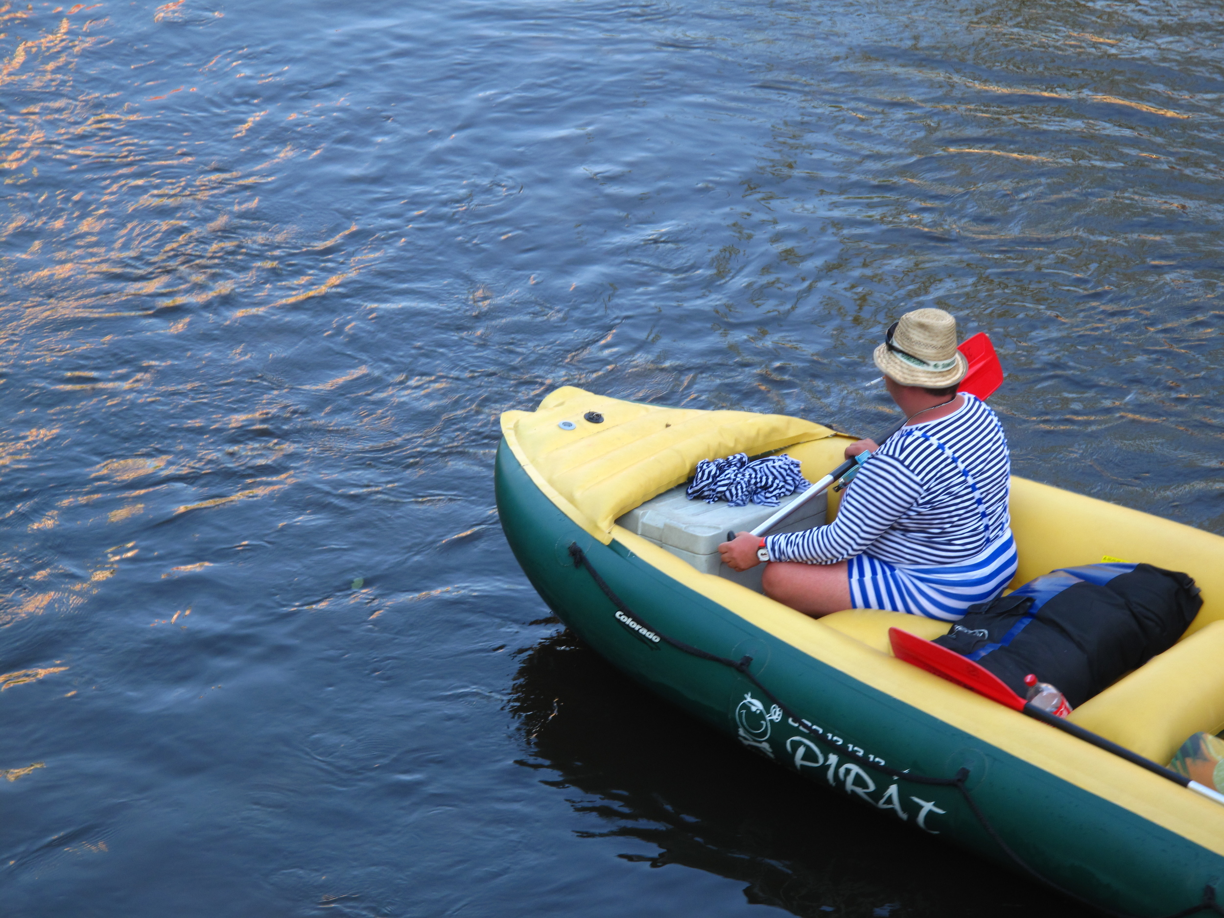 Funny Czech men in swimsuits canoeing and smoking