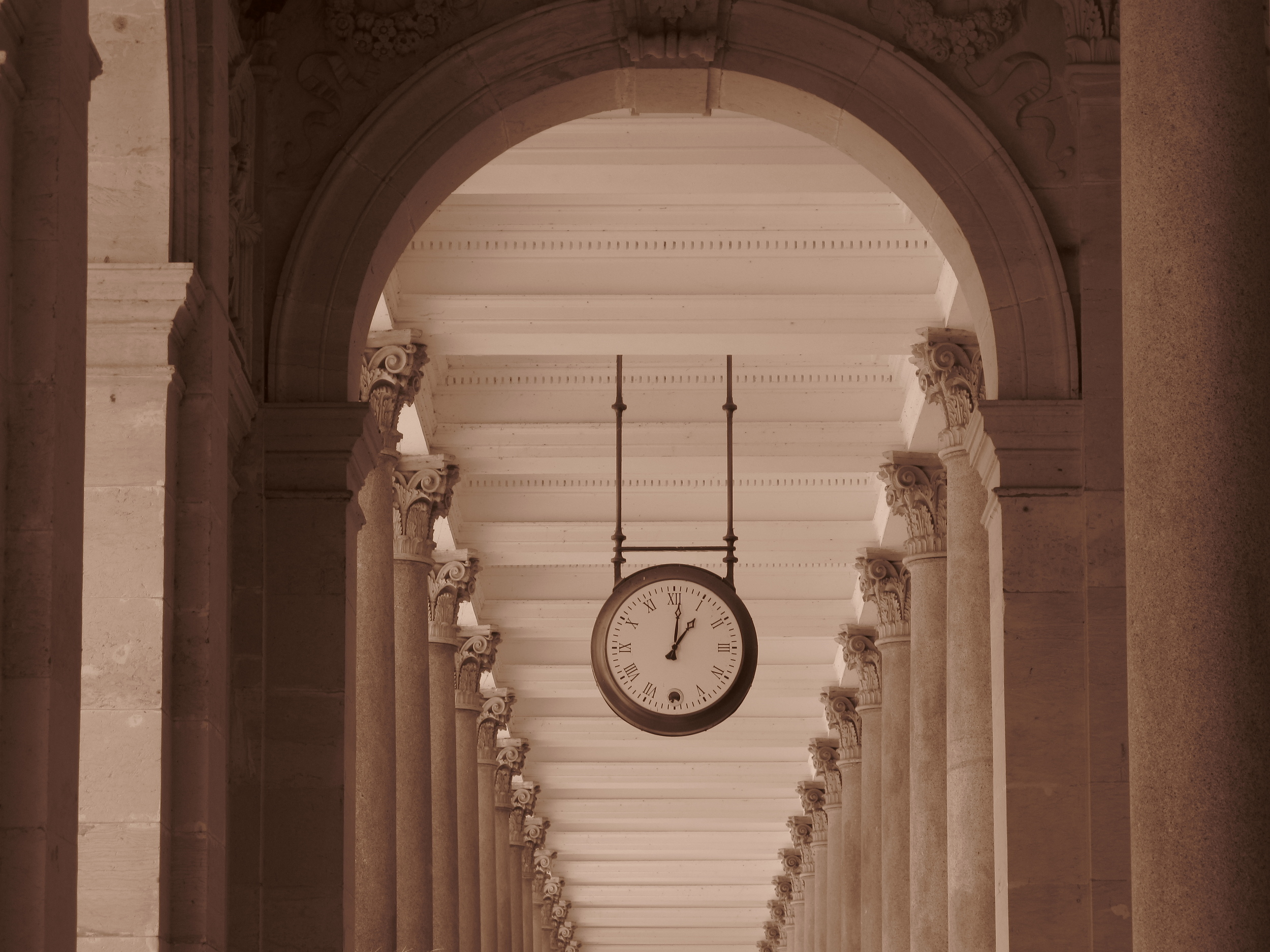 Old clock in a promenade, Karlovy Vary.