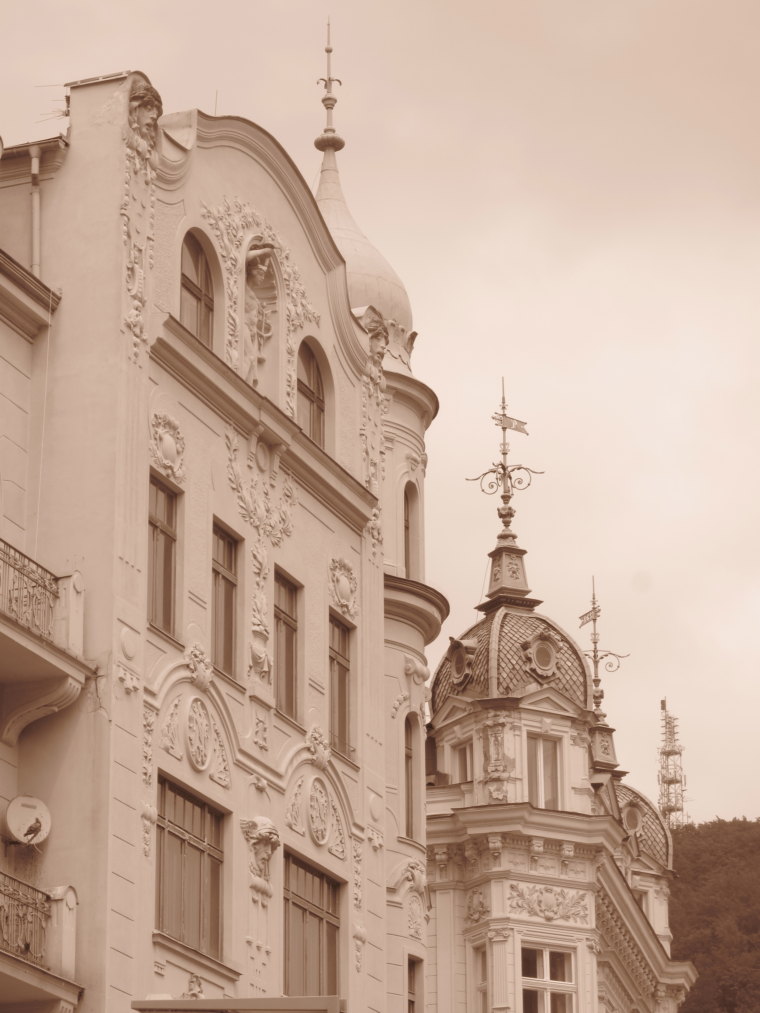 Architecture in Karlovy Vary old town - wooden houses, parapets and spires.