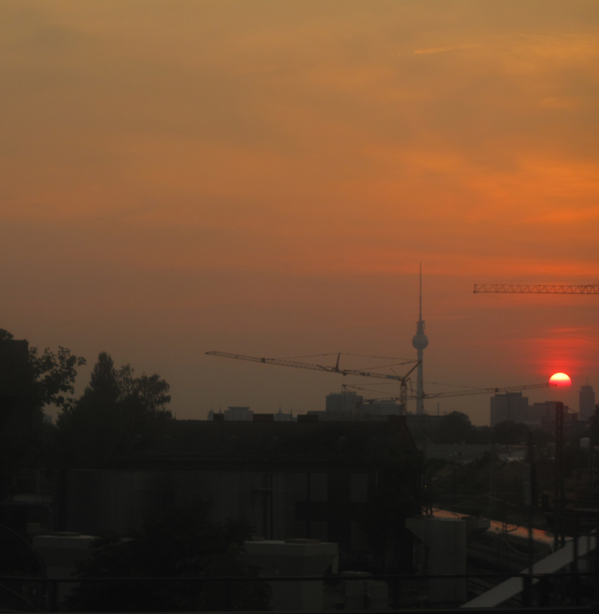A red sunset in the smog of Berlin.