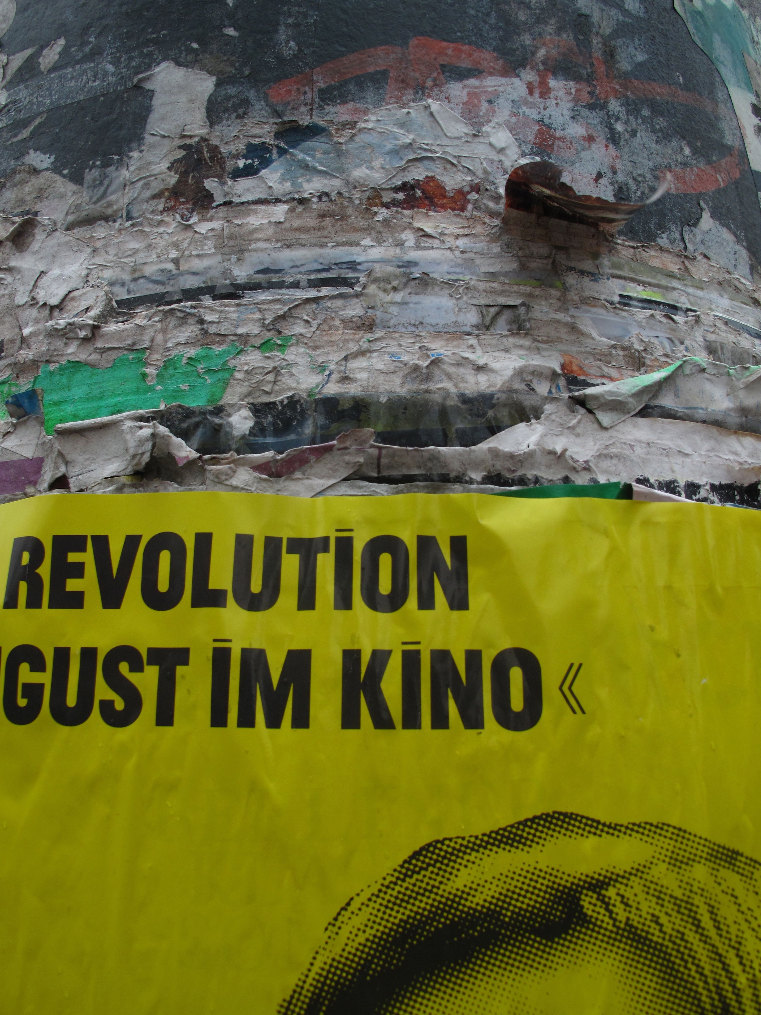 Layers and layers of posters on a lamp post, in Berlin.