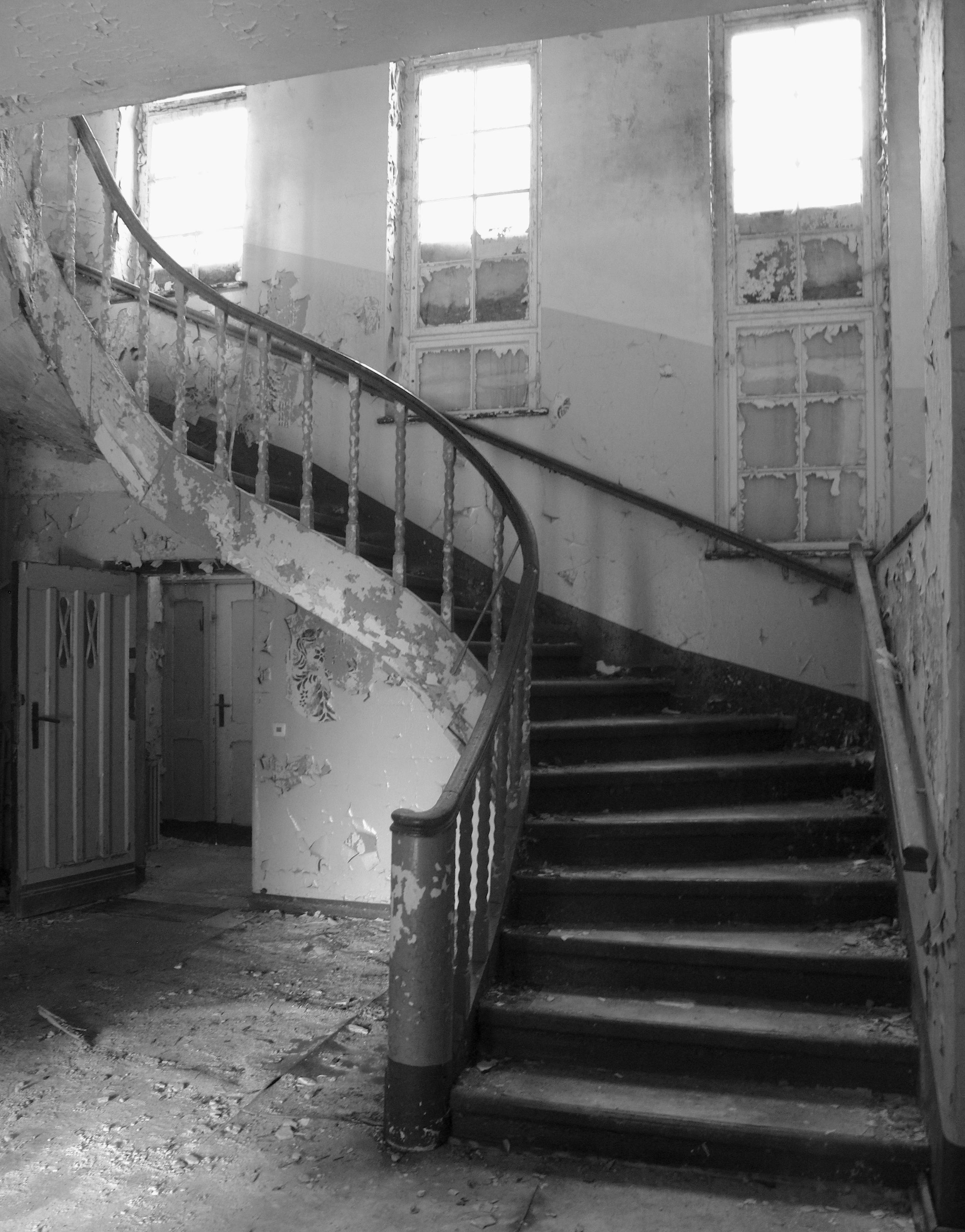 Curved staircase inside the abandoned Elisabeth Sanatorium, Berlin.