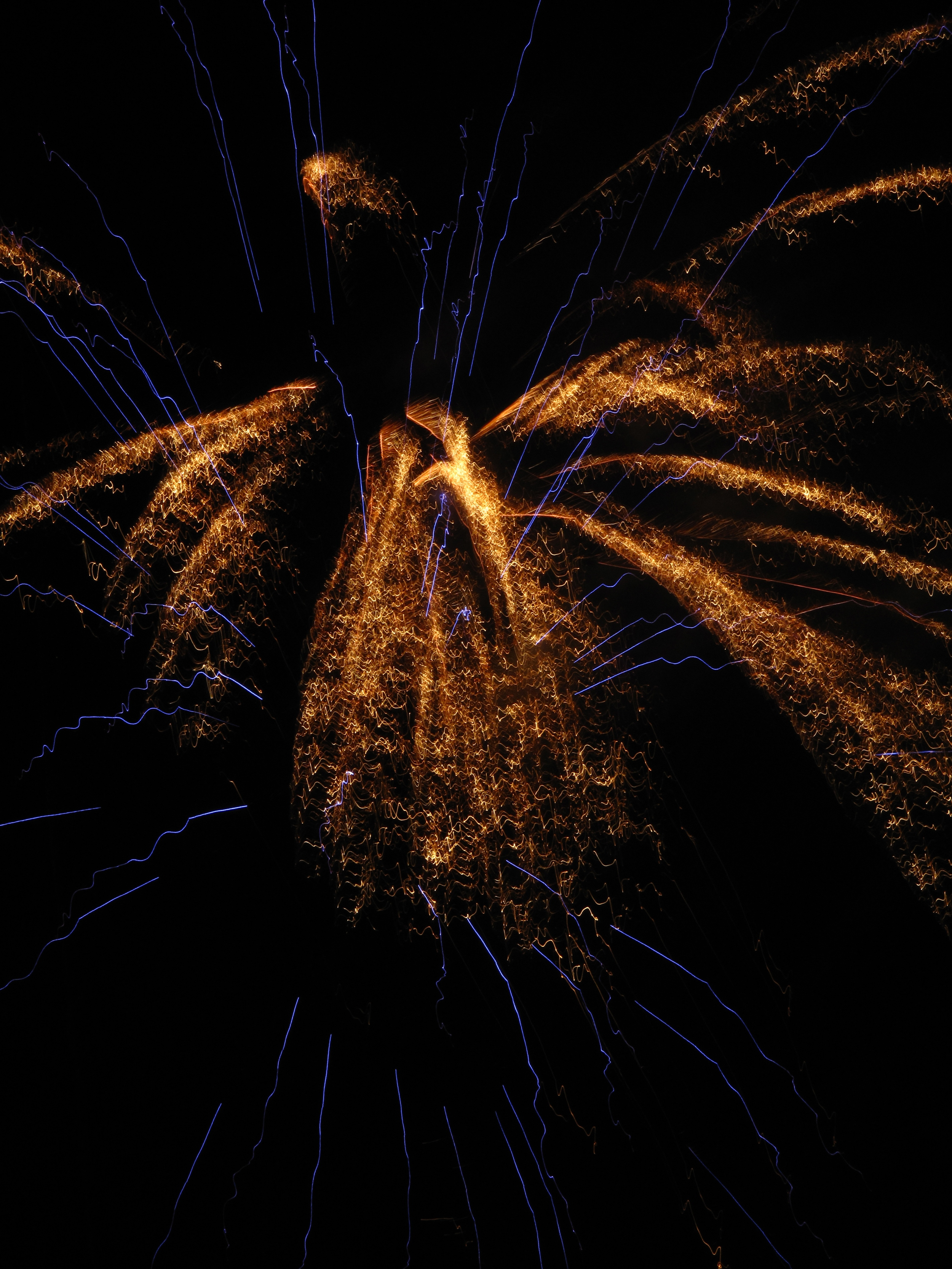 Blue and gold fireworks burst, Les Eyzies de Tayac, France.