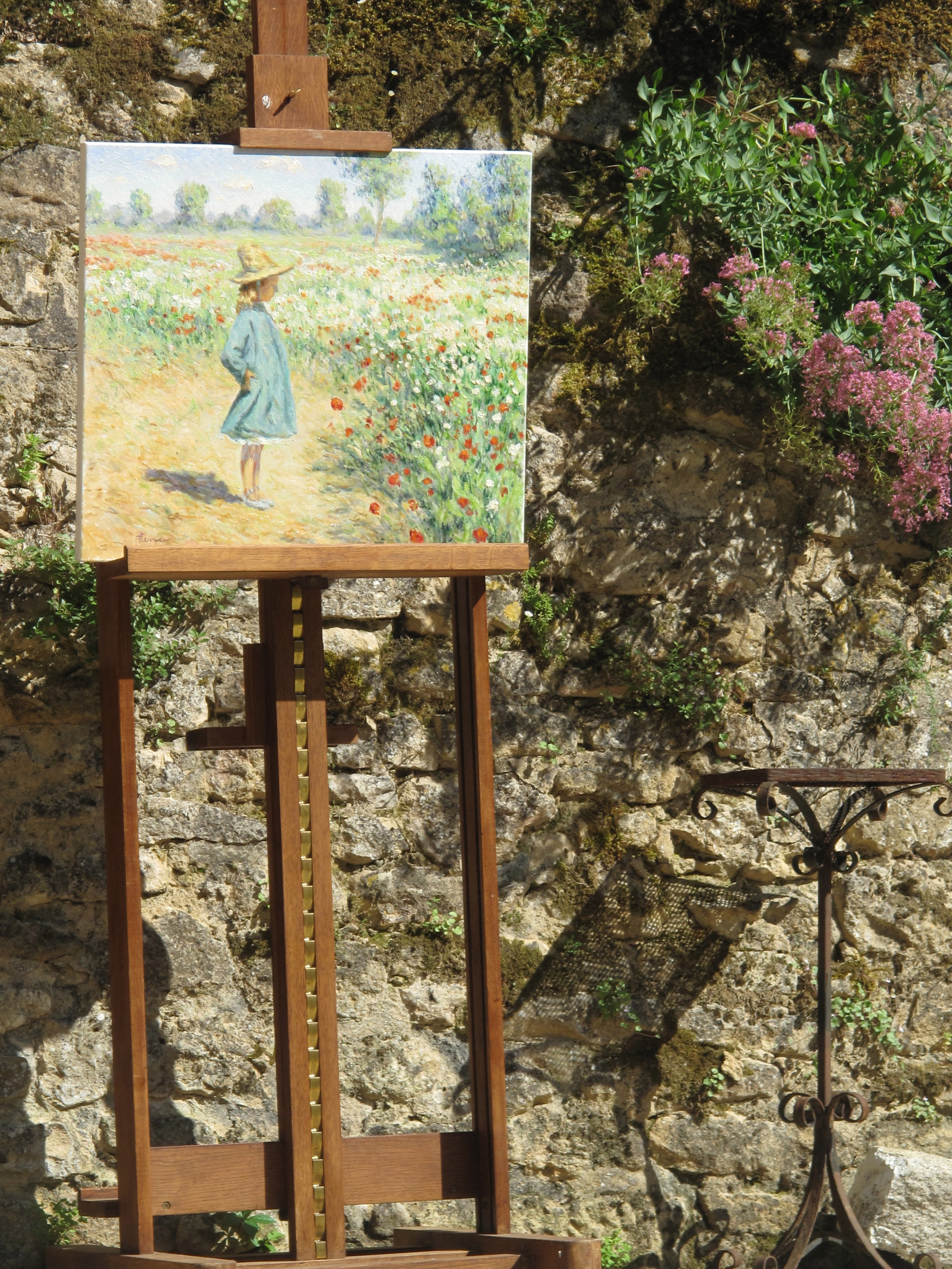 Oil painting by an artist in the Dordogne - of a girl and fields of flowers
