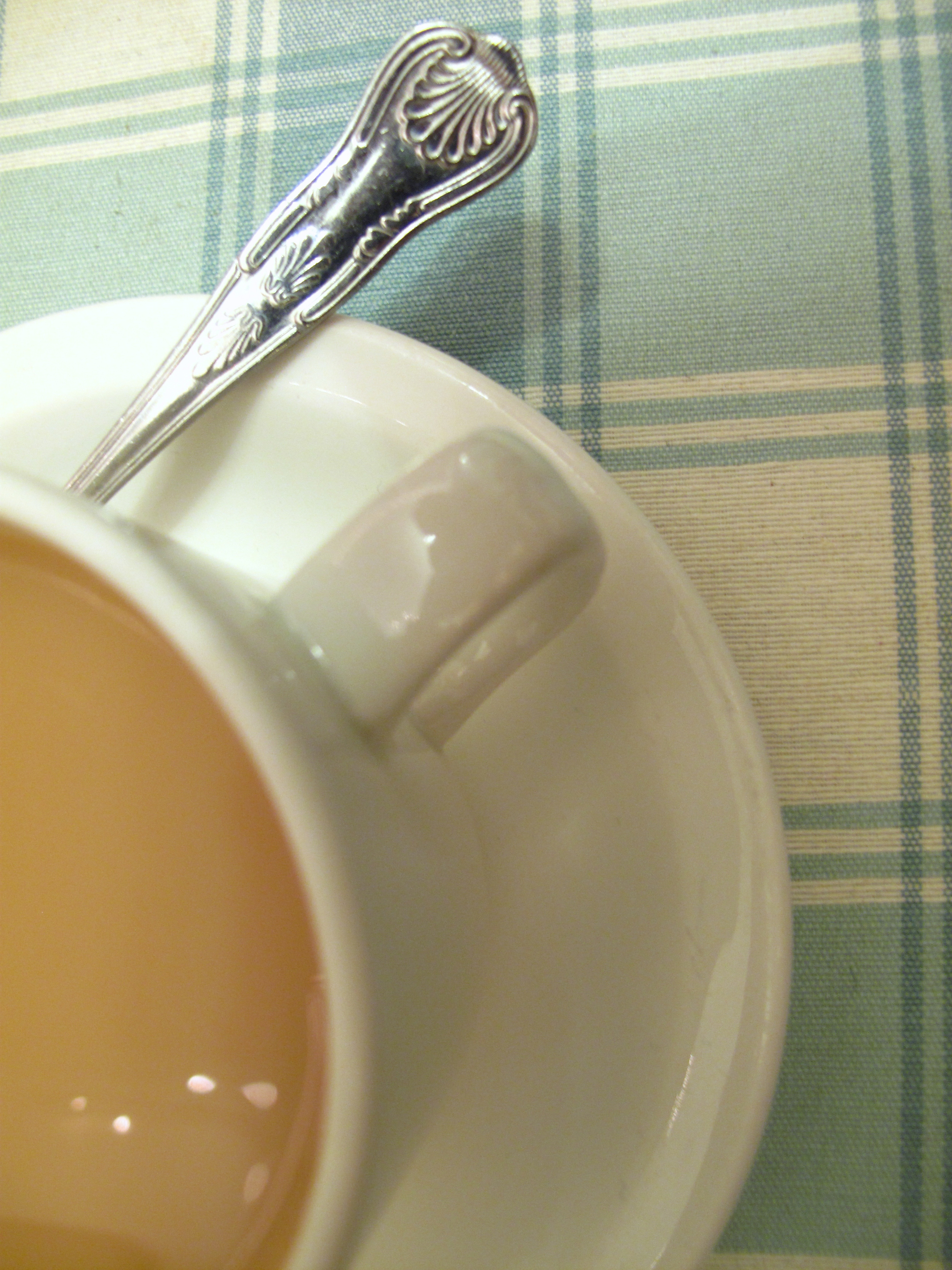 A cuppa tea and a blue table cloth.