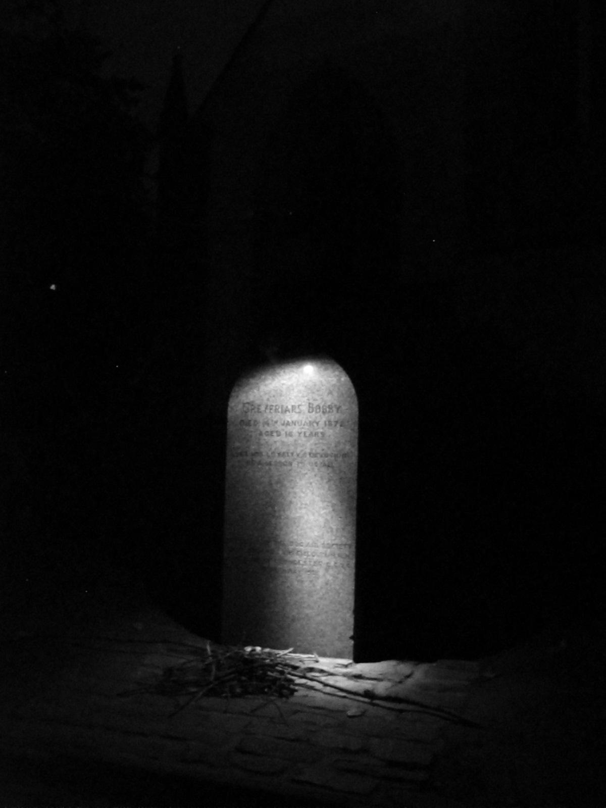 Greyfriars Bobby - grave of the dog, at night.