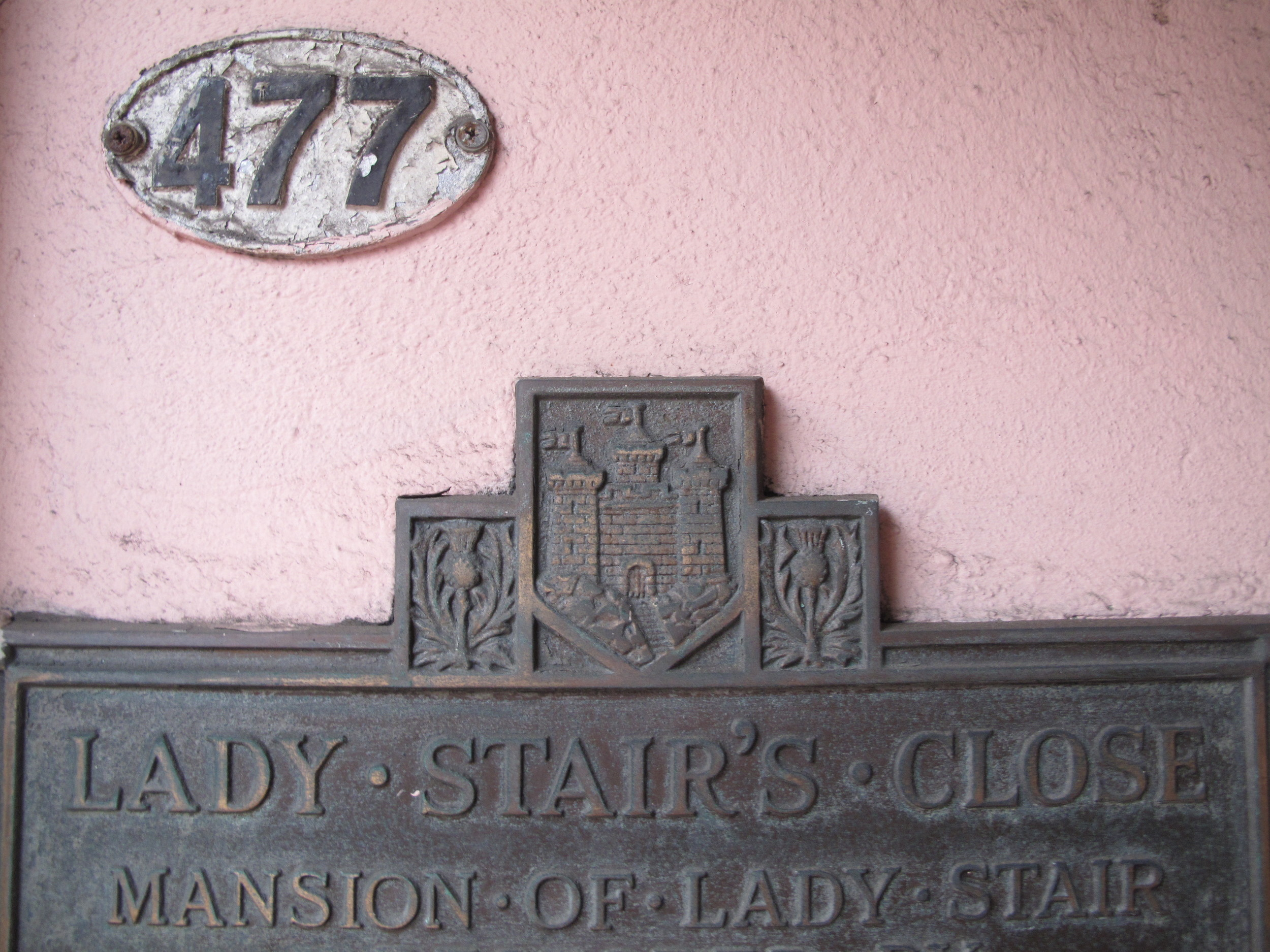 Lady Stair's Close sign on pink wall, Edinburgh.