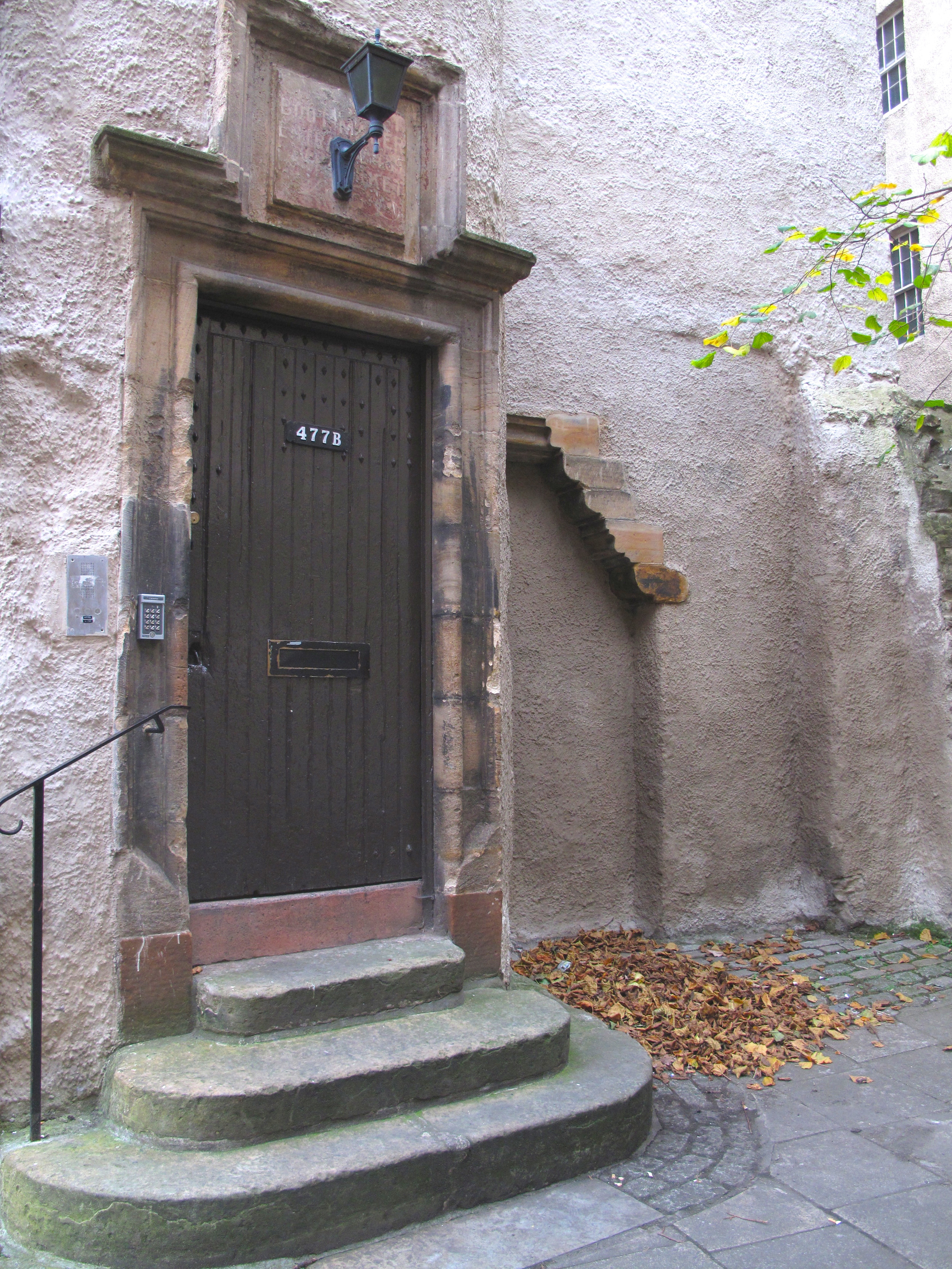 Pink walls and a door in the courtyard behind Lady Stair's Close, Edinburgh.