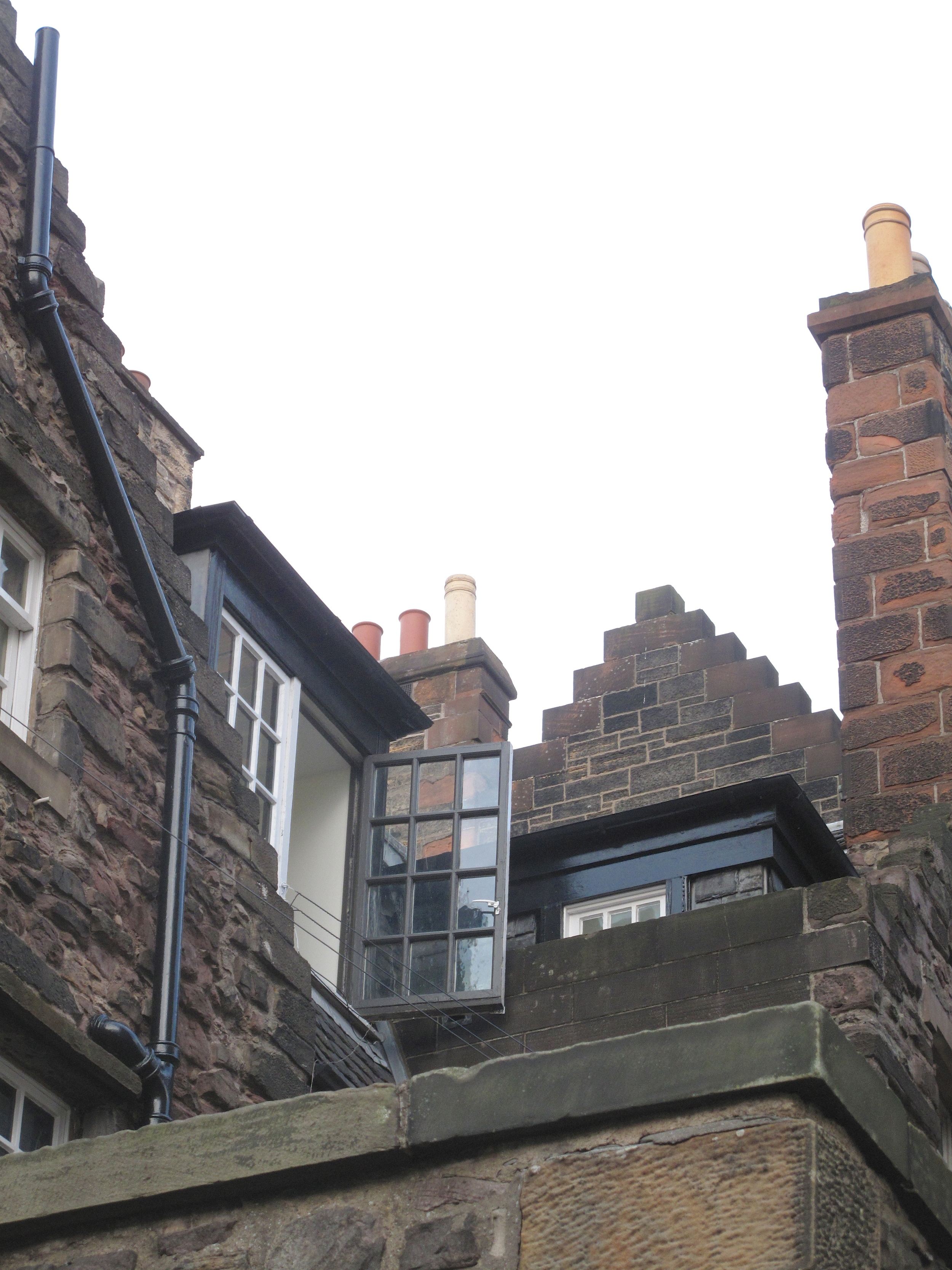 Rooftops of houses and chimneys in Castle Wynd, Edinburgh.
