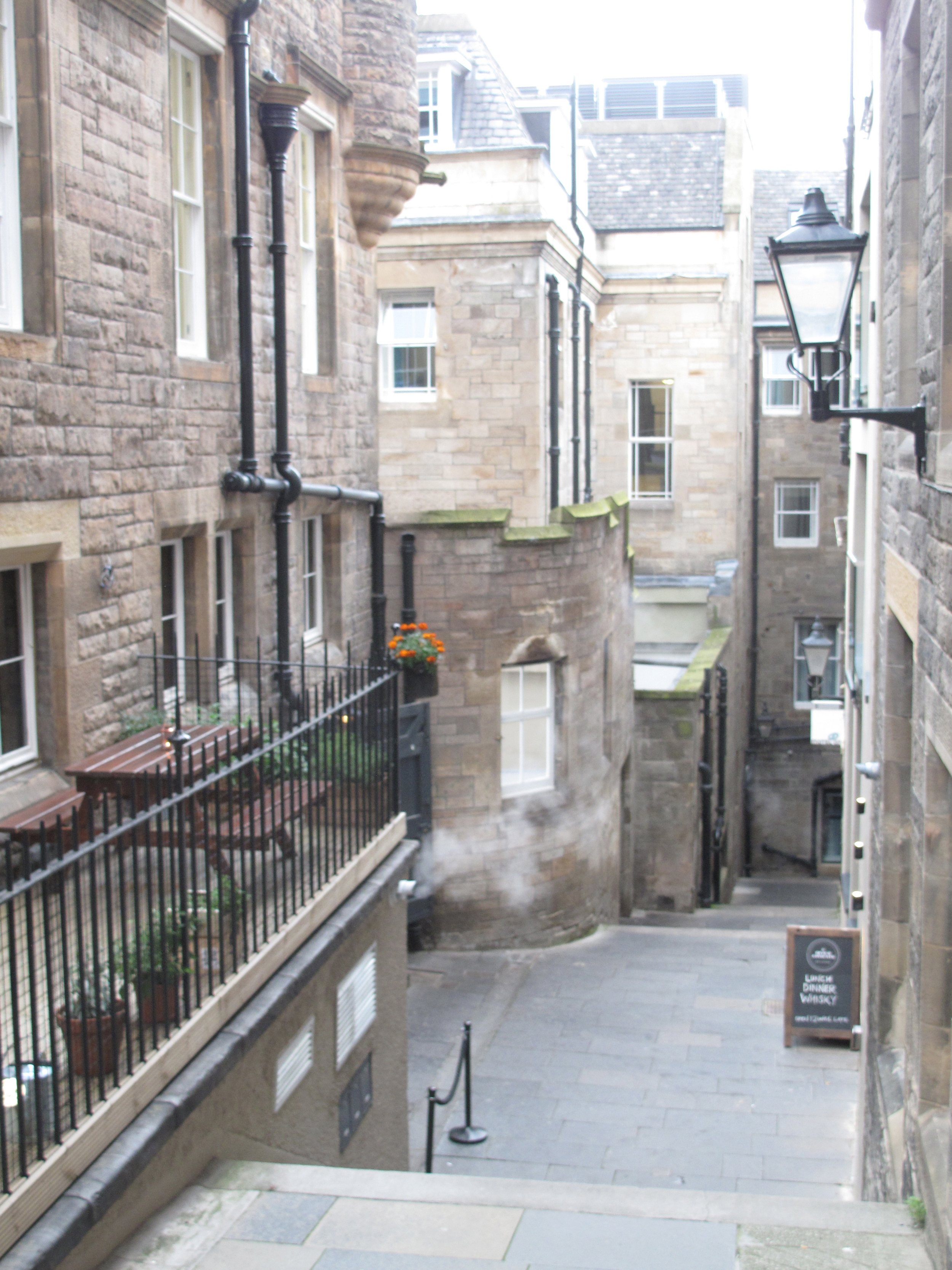 Wynd through a bright alley in the Old Town of Edinburgh.
