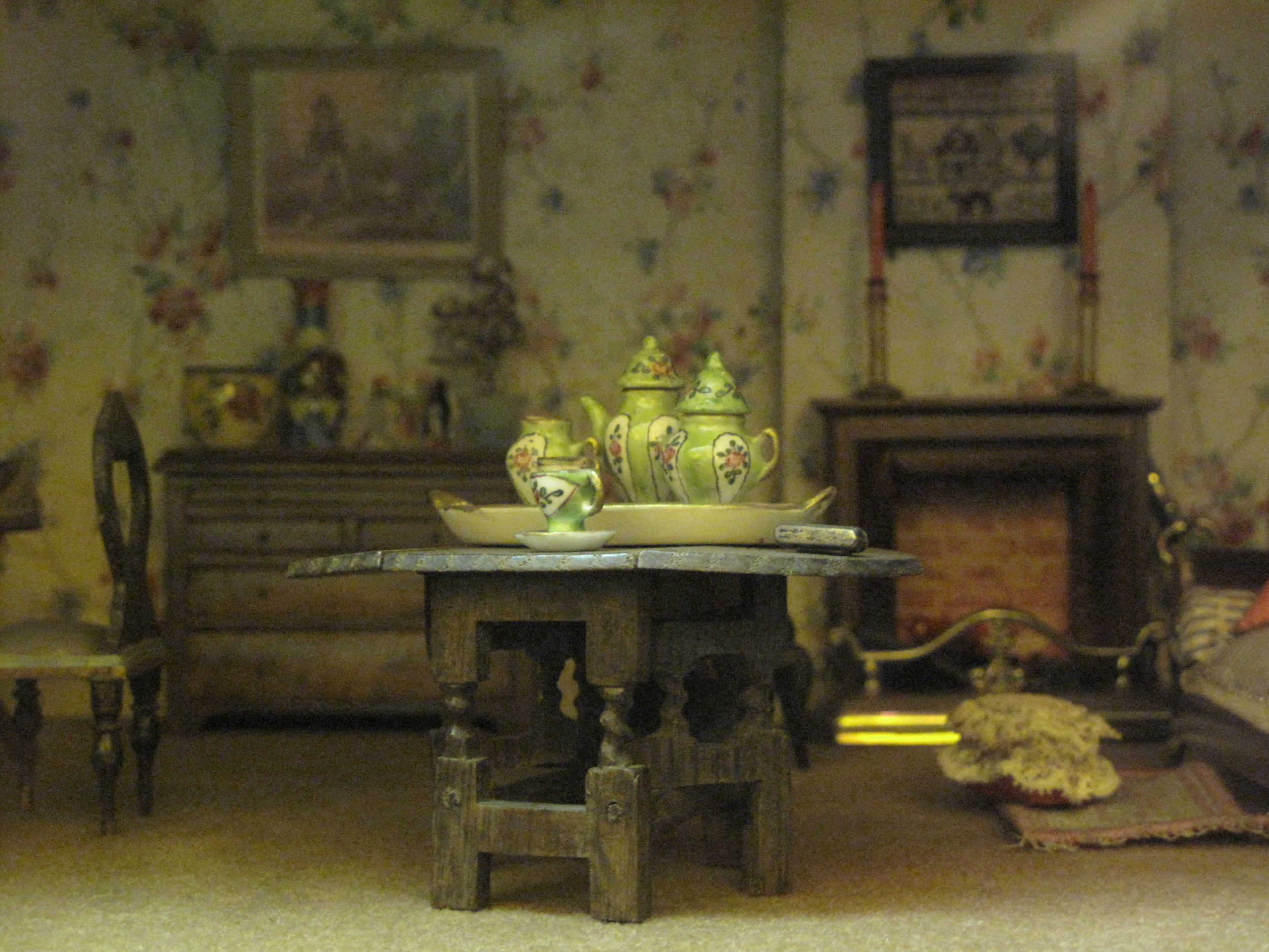 Tiny tea set in a doll's house.