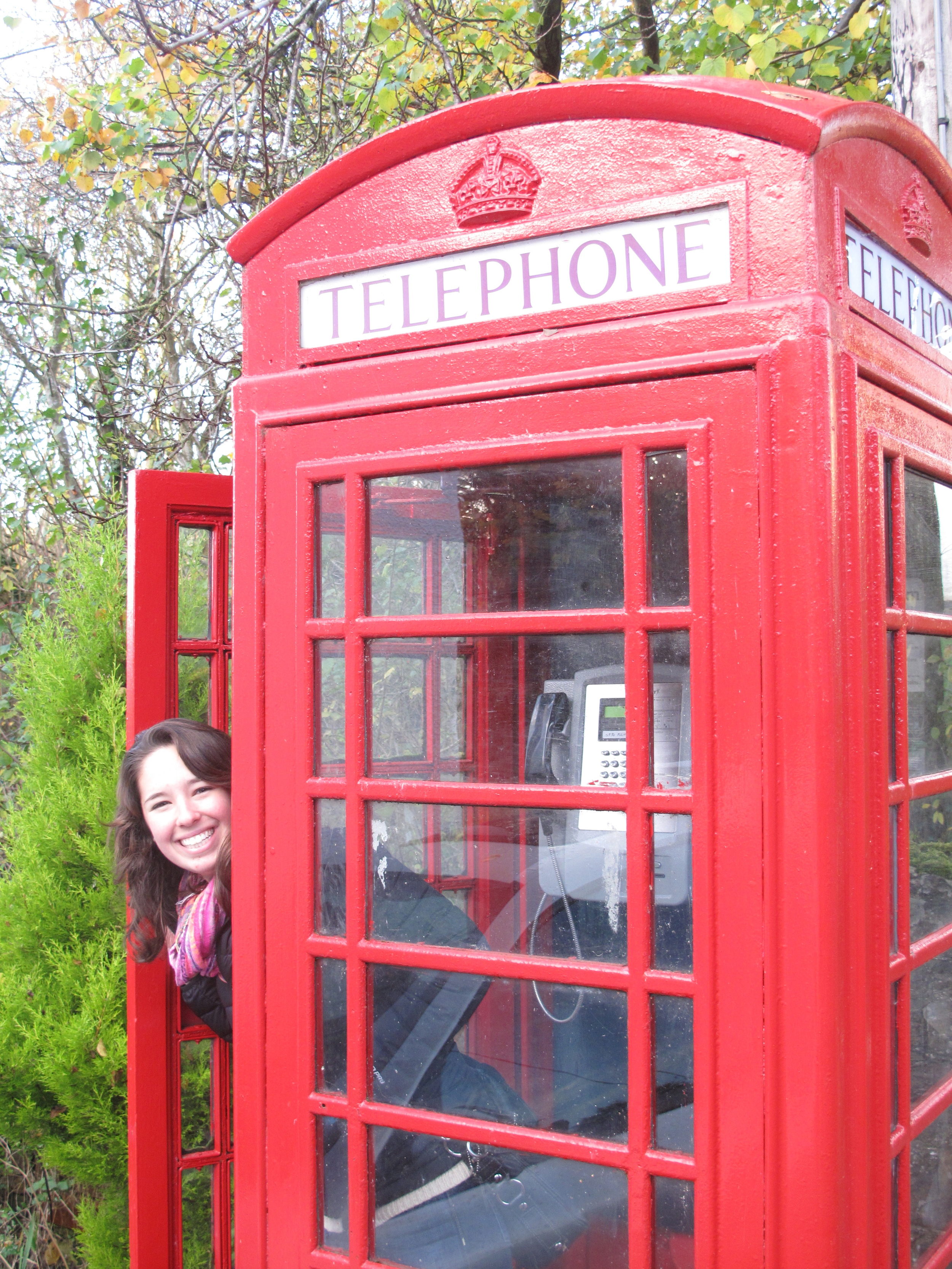 Claire hiding in a red telephone box, in the tiny Scottish village of Melrose.