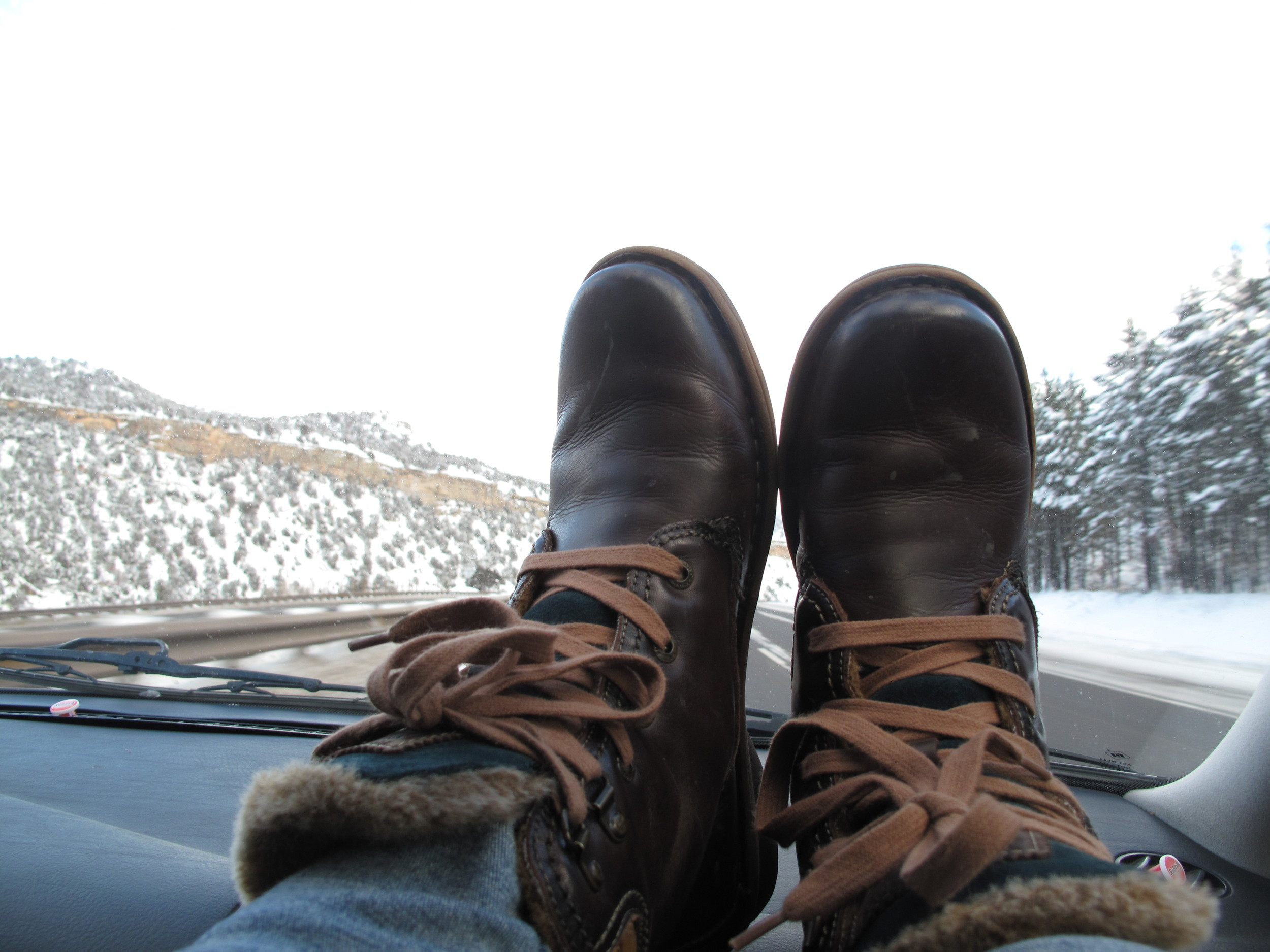 Winter boots on the dashboard, road trips.