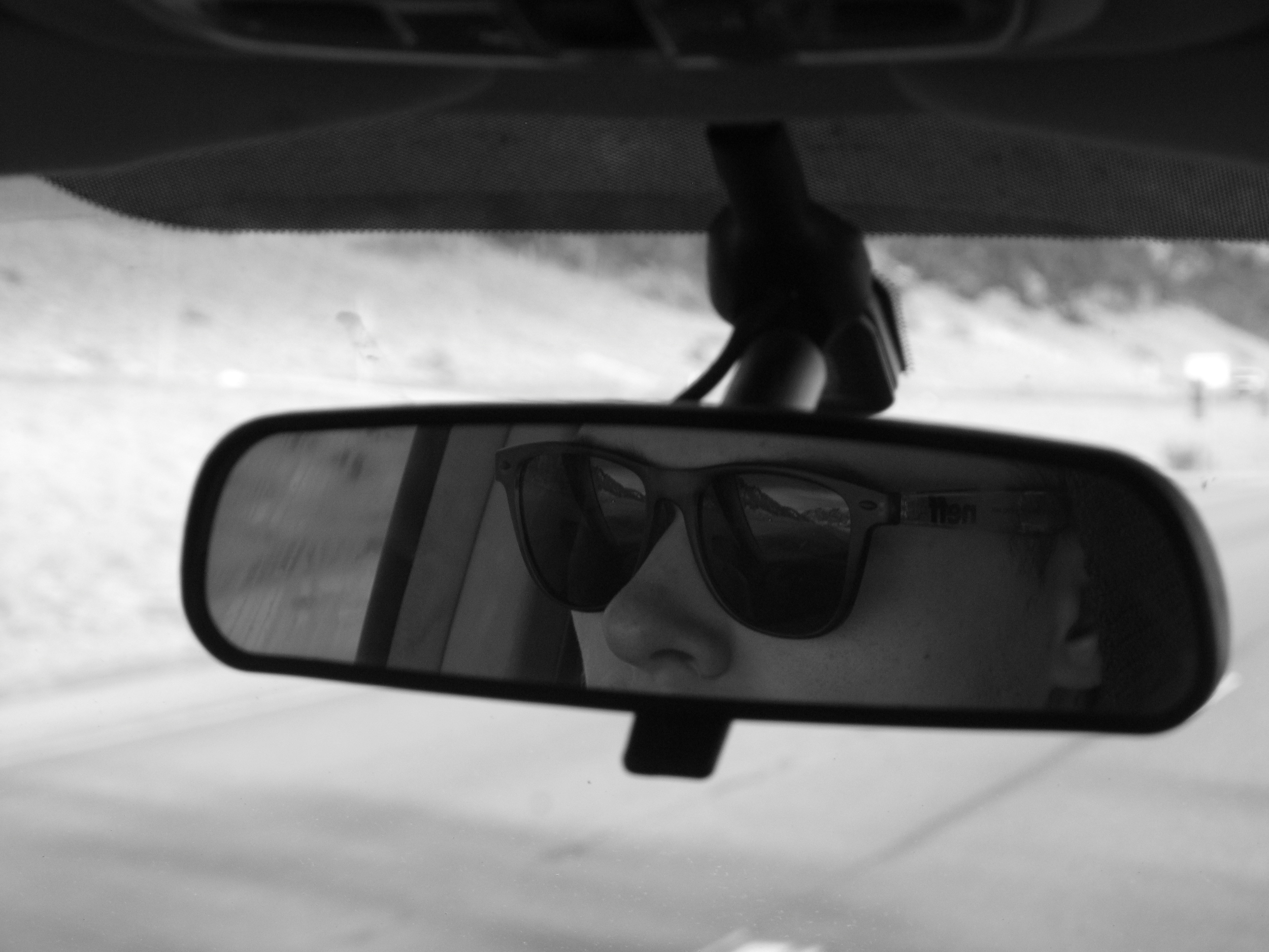 Sunglasses and road trips - reflections in rear view mirror.