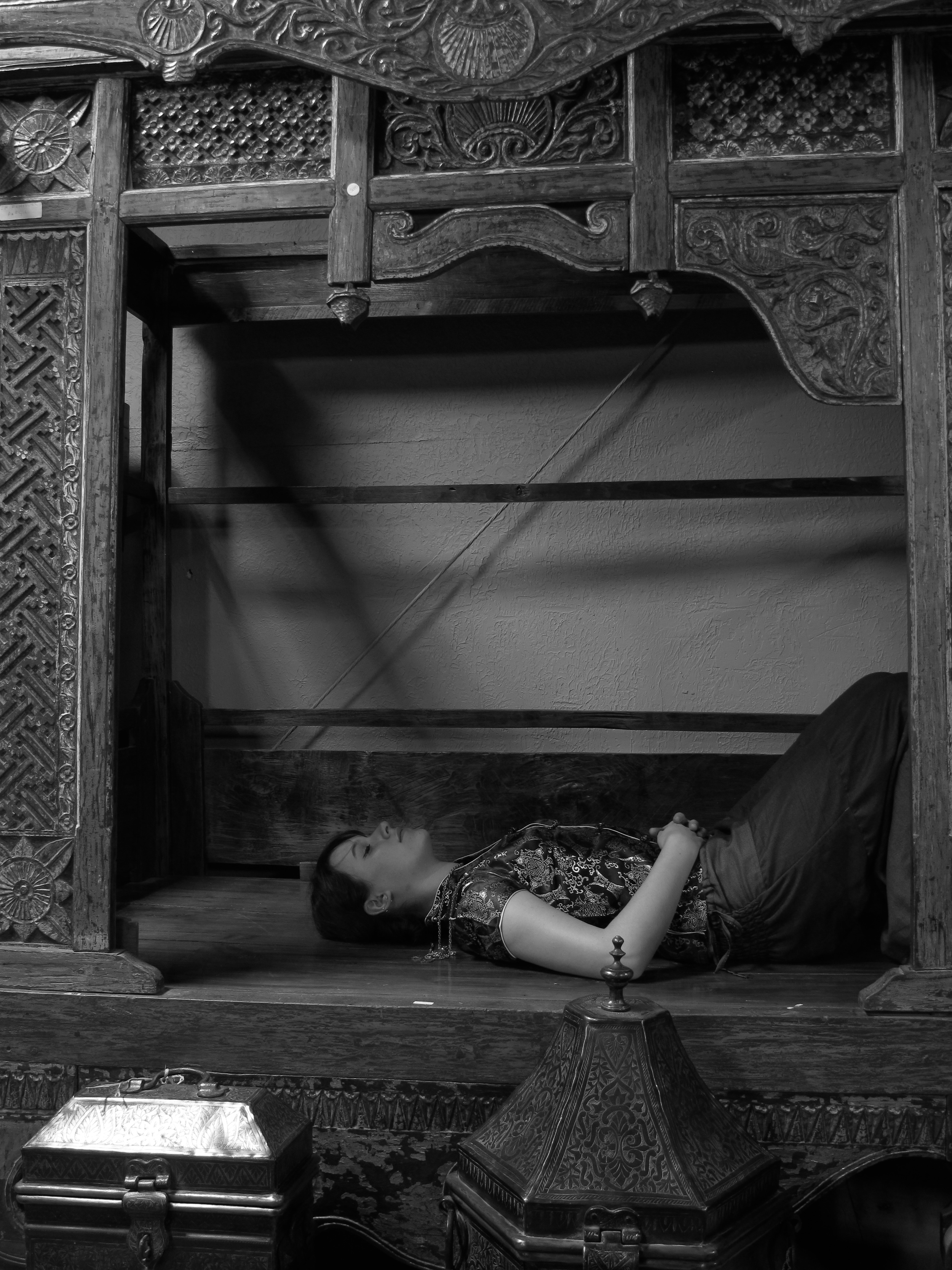 East Asian style photoshoot, with oriental bed and containers