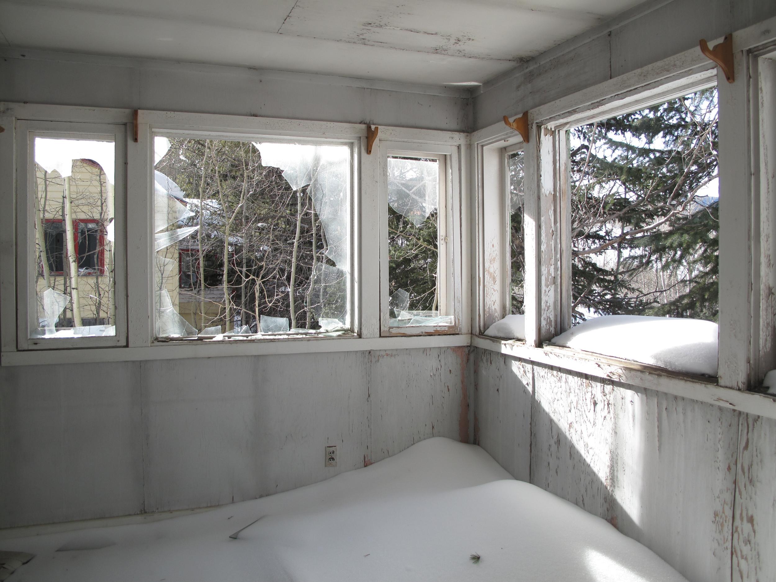 Snow inside an abandoned house - eery silence. Gilman CO.
