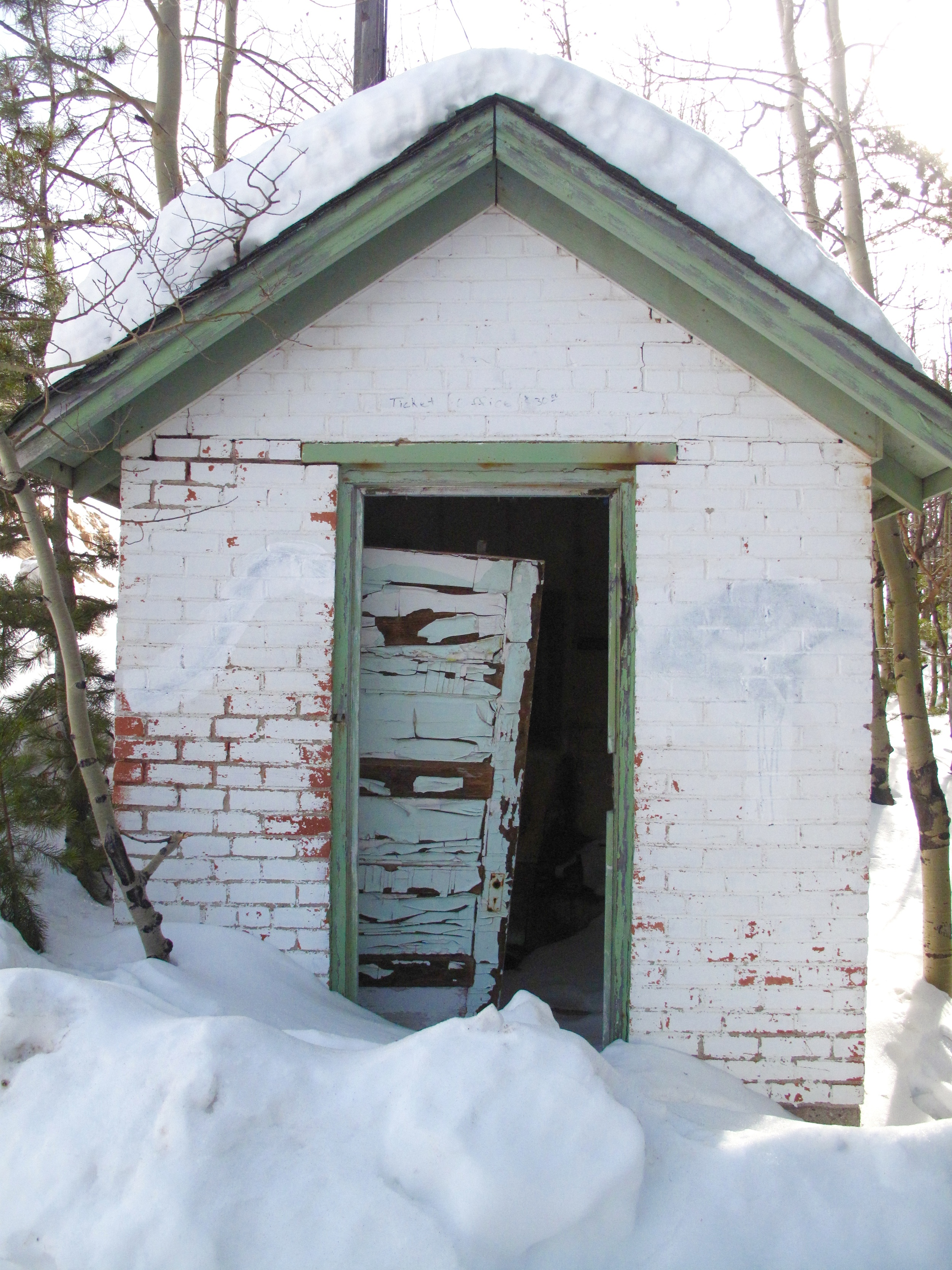 Little hut covered in snow, on the border of Gilman abandoned mining town.