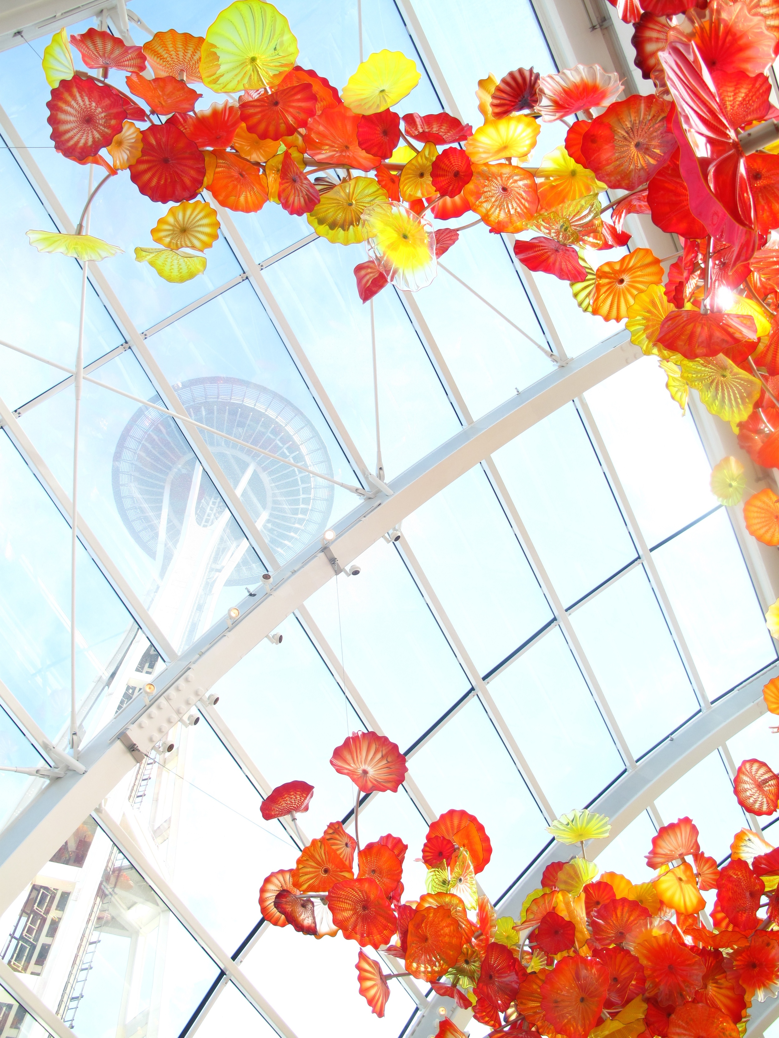 Vie of the Space Needle from Chihuly Museum, under the beautiful glass flowers.