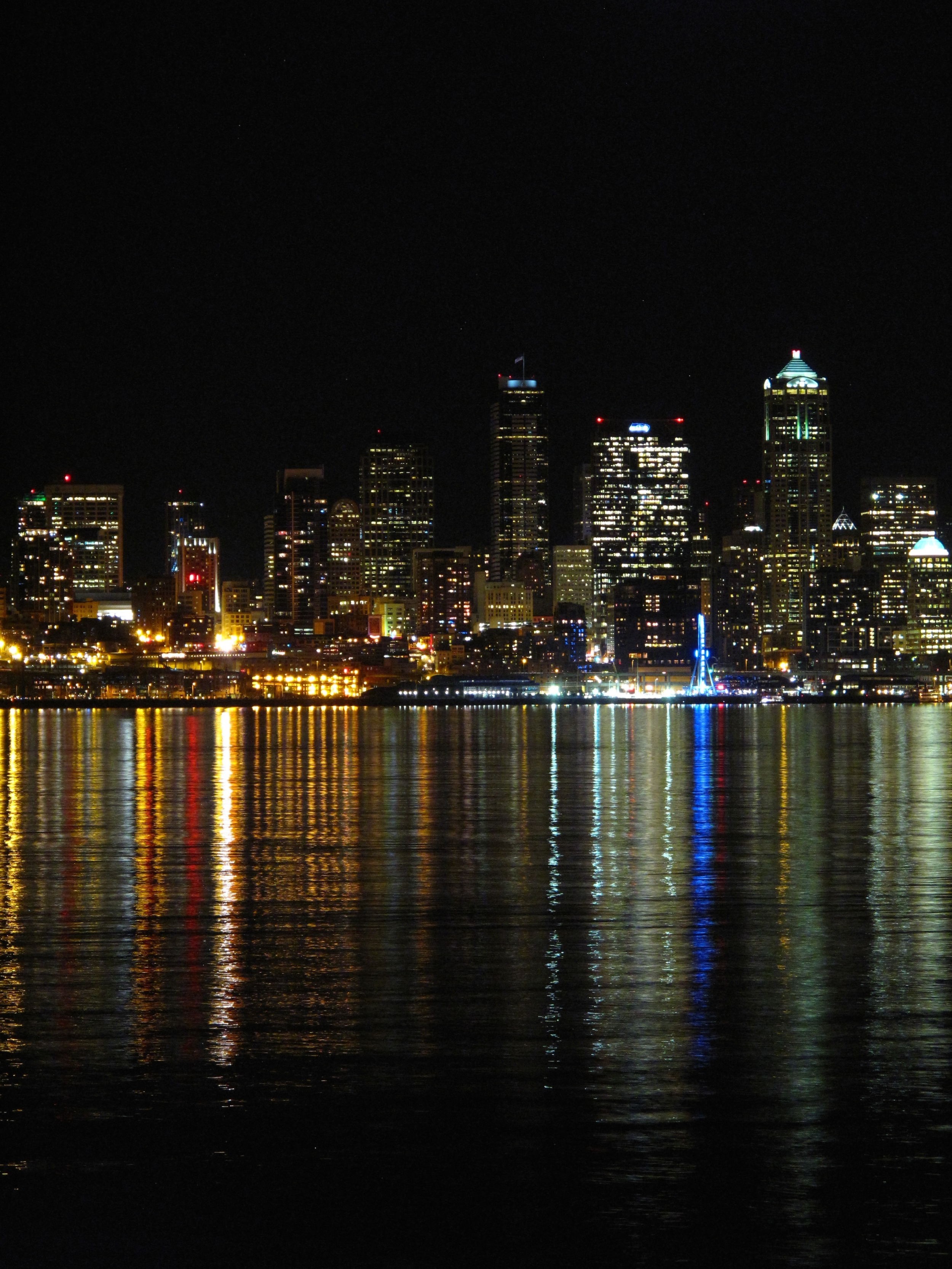 Alki Beach view of Seattle skyline at night - with all the lights on the water.