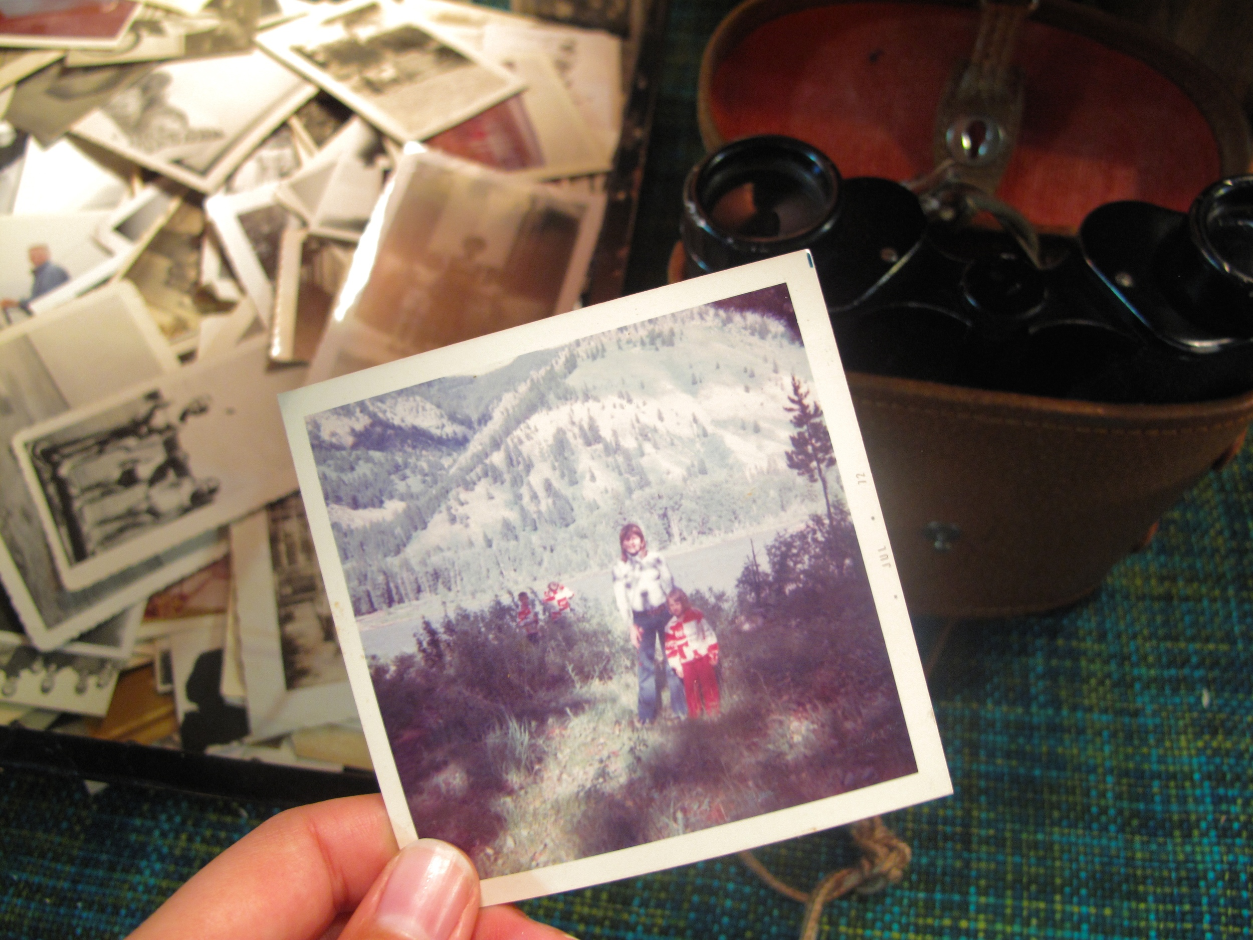 An old photograph of a family camping and binoculars,at a thrift shop in Seattle.