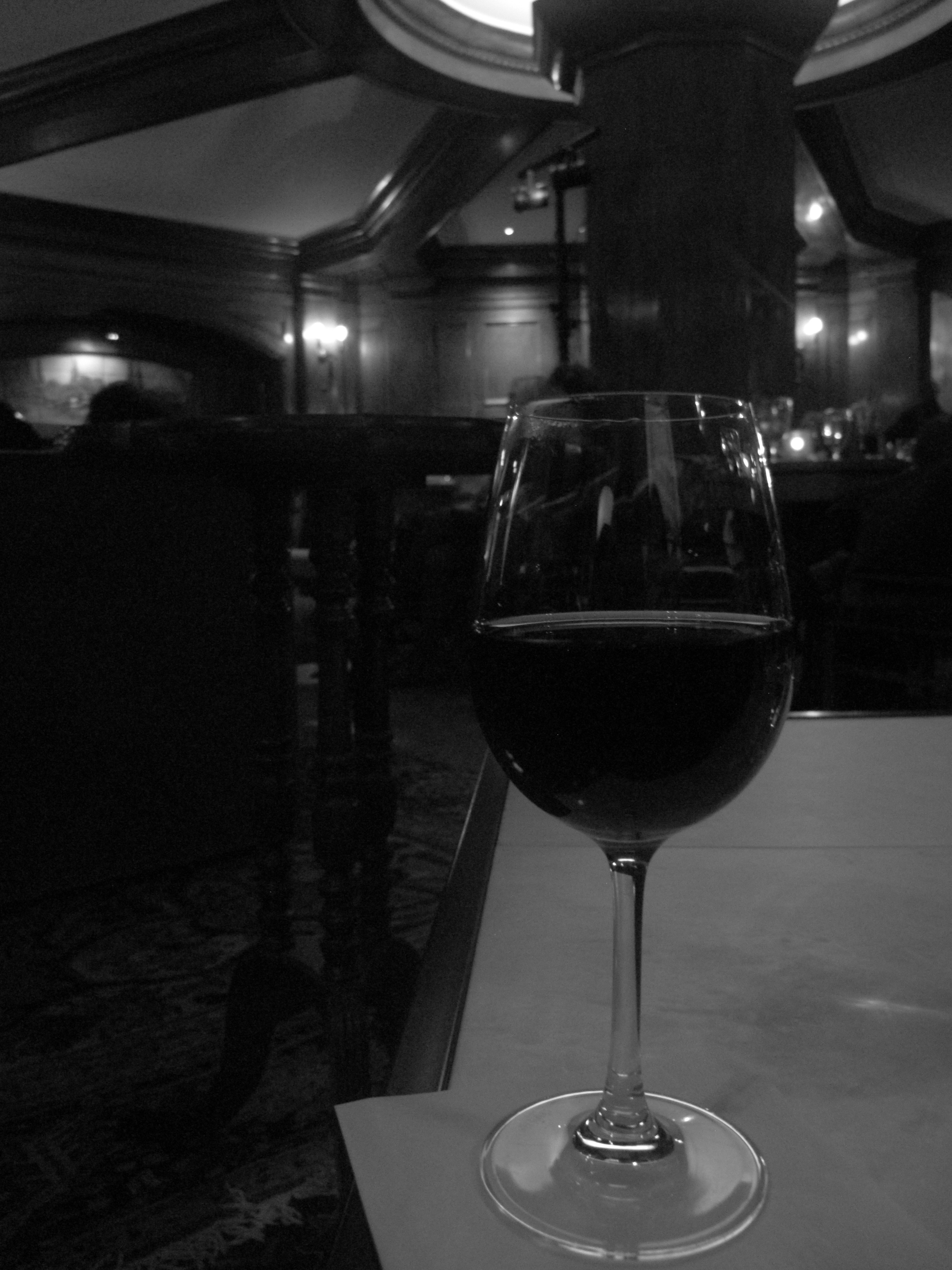 A glass of wine and some jazz in a hotel lobby.