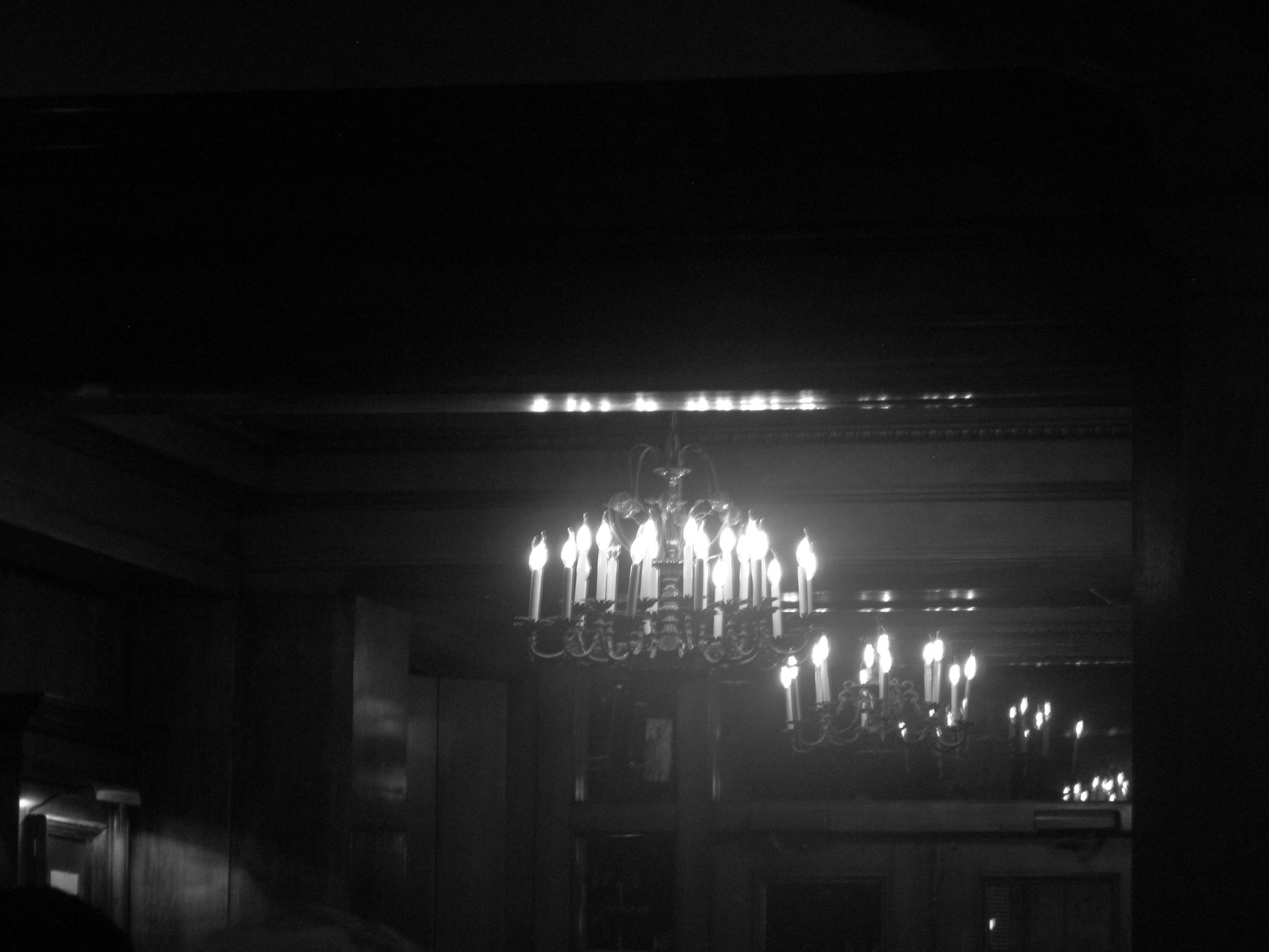 Chandelier in a hotel lobby, black and white photography.