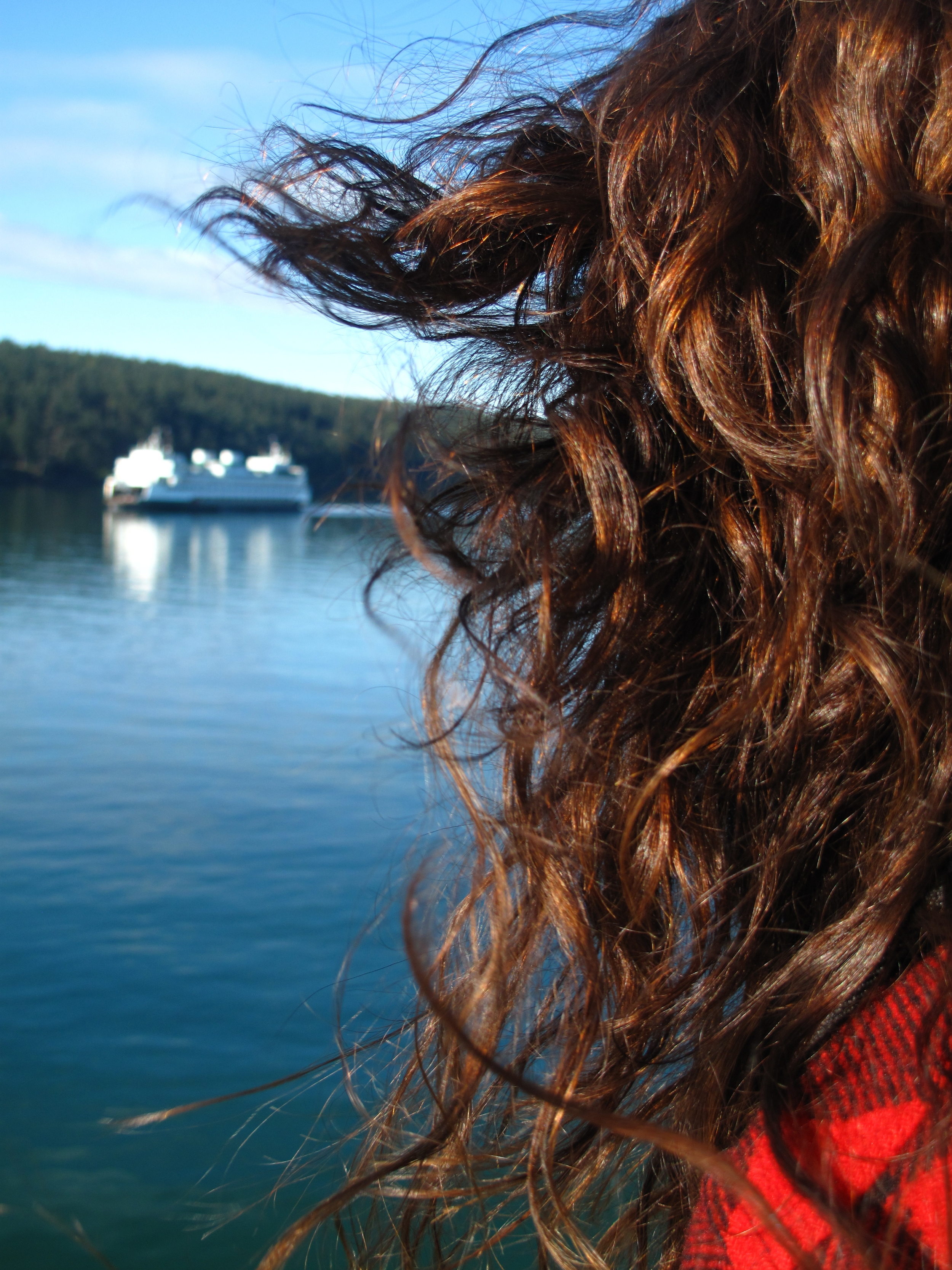 Nicole's hair blowing in the wind as we sail along the coast in the San Juans.