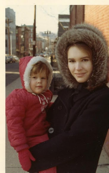 My grandma with my mother as a child.