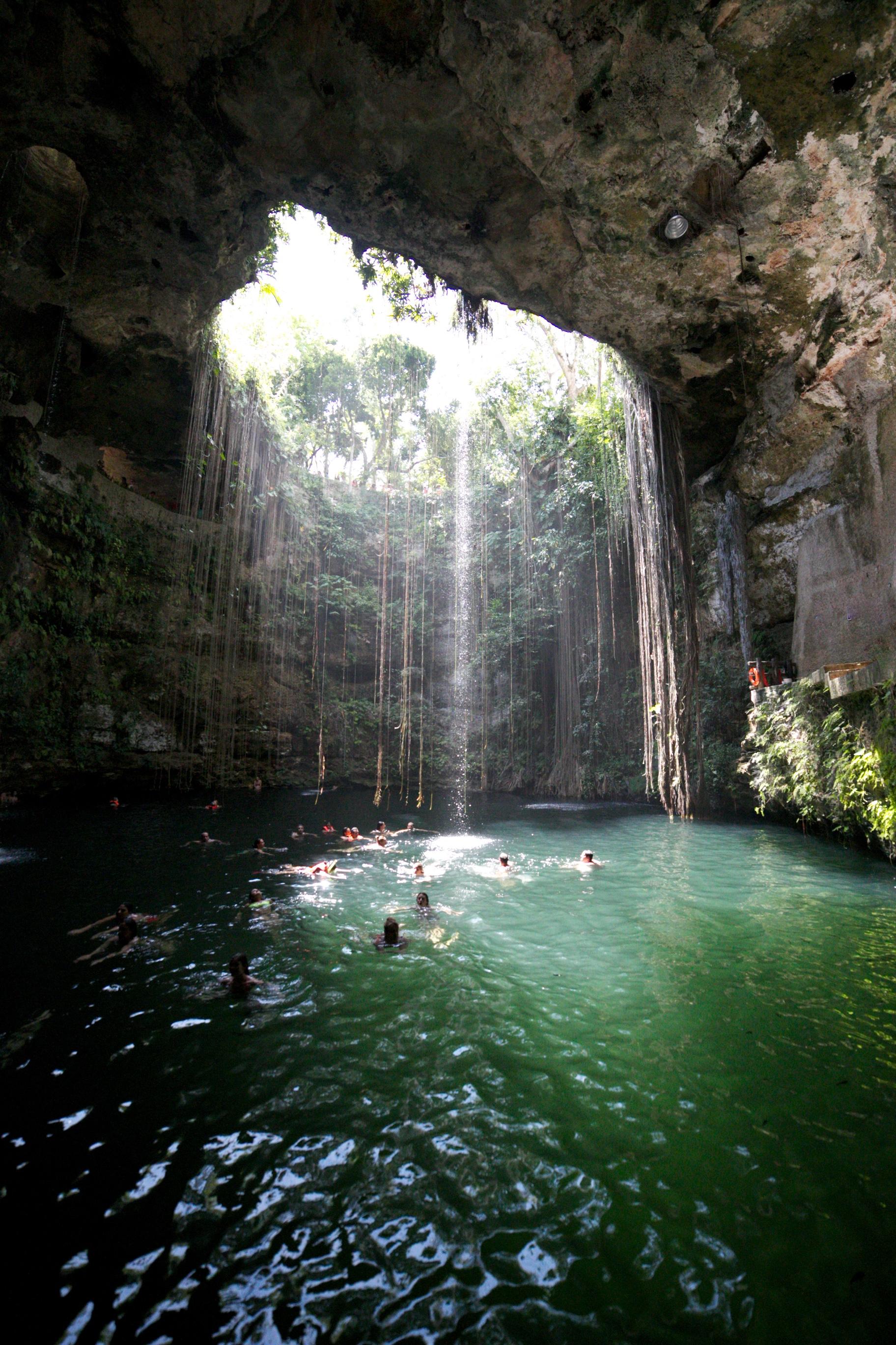 Ik Kil Cenote swimming in Cancun, Mexico.