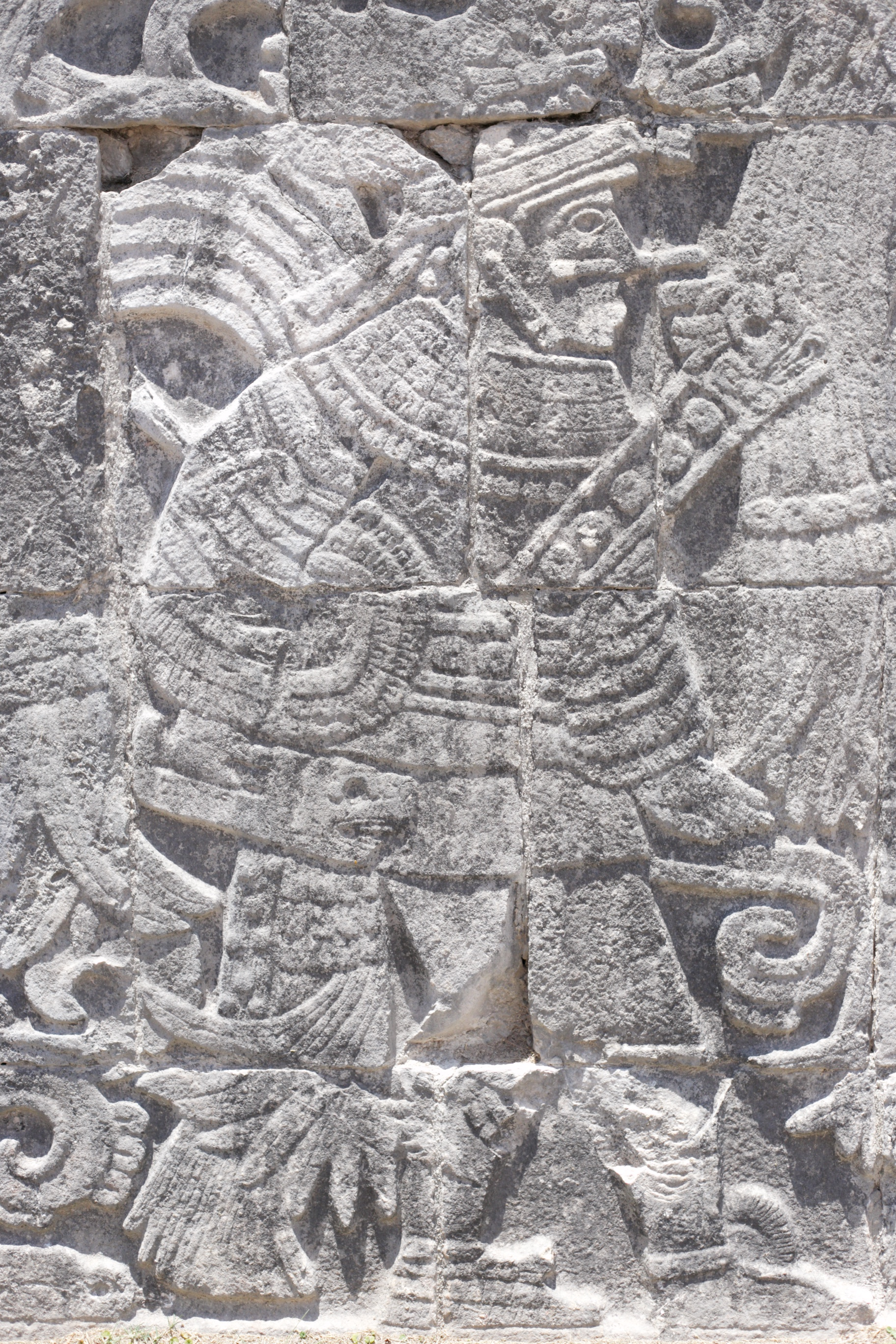 Mayan carving of a warrior or ball player in the old ball court Chichen Itza.