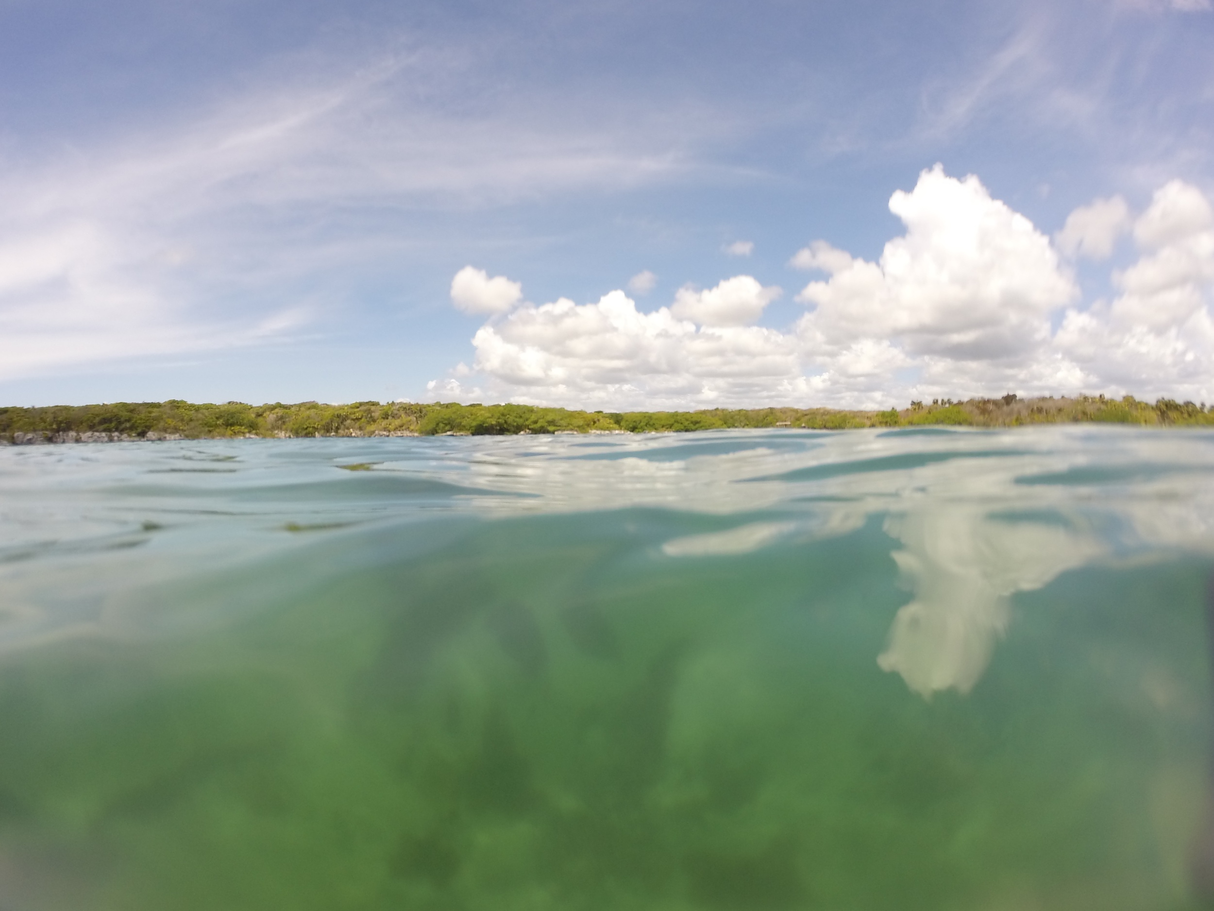 Green waters and puffy clouds at Xel Ha lagoon, Mexico.