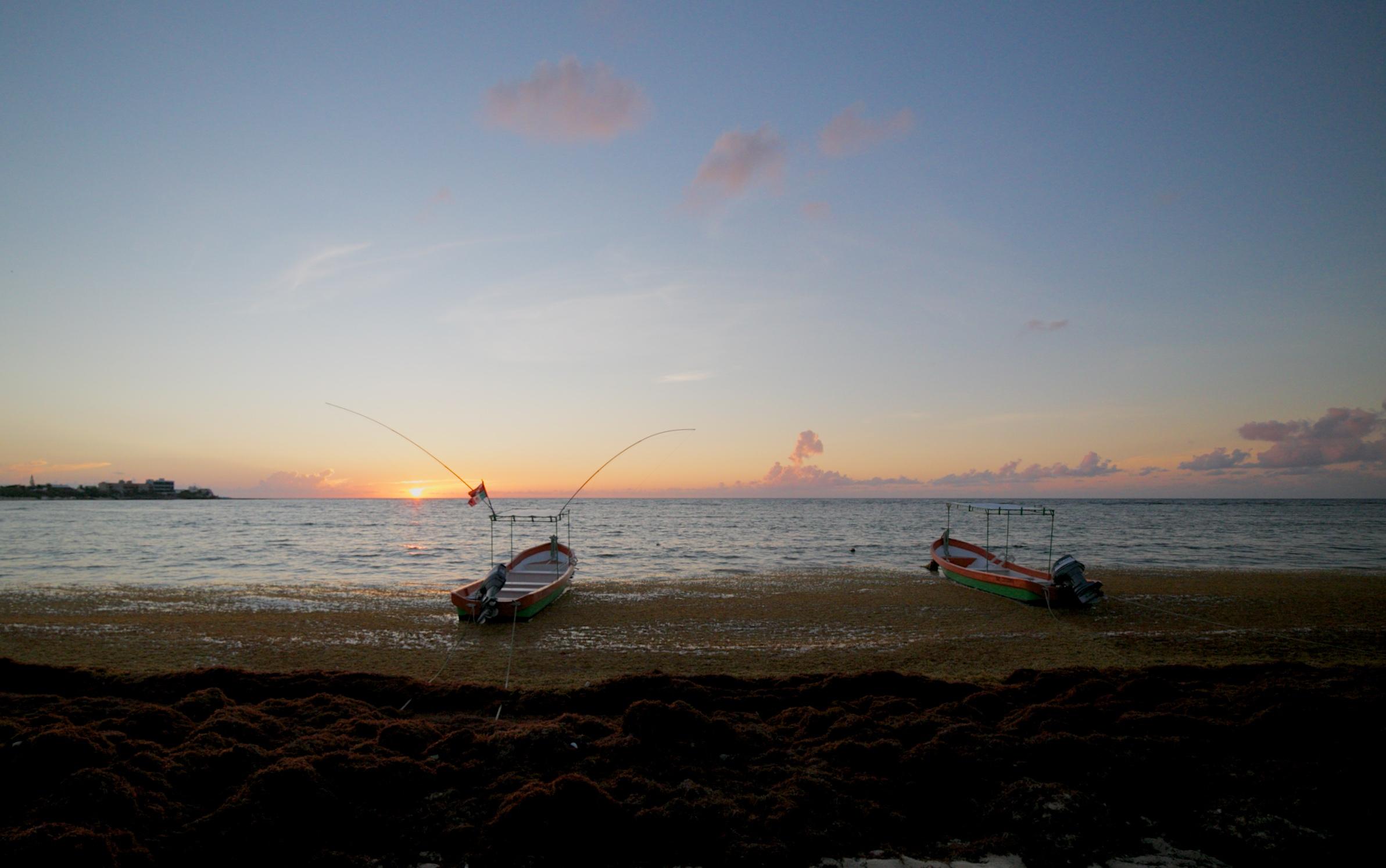 Two fishing boats on Half Moon Bay at sunrise, Akumal, Mexico.