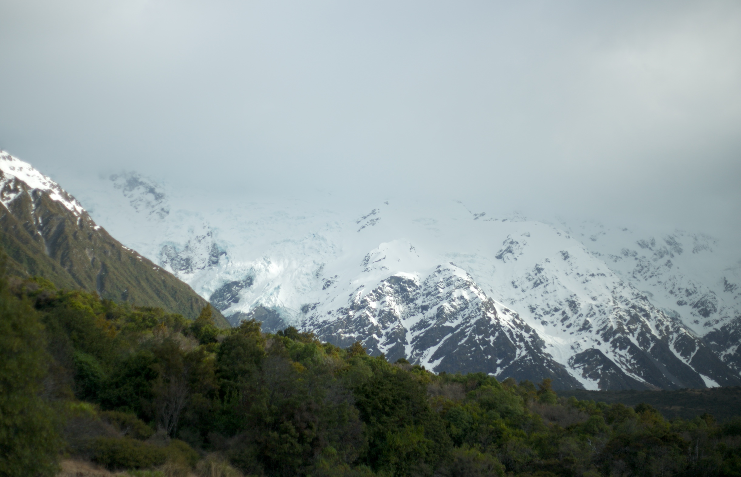 New Zealand mount cook shrouded in fog, like Caradhras, from Lord of the Rings.