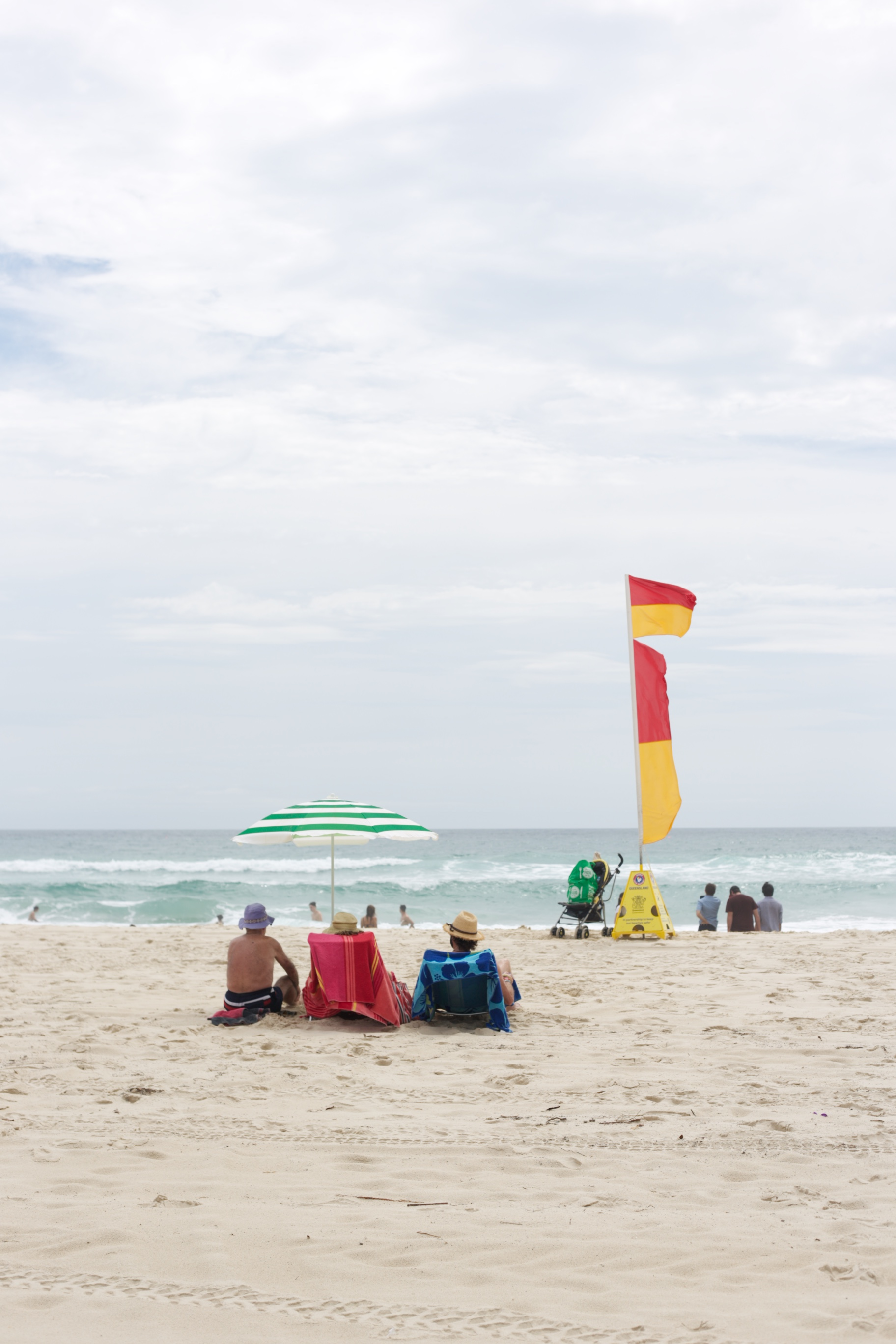 On the beach in Brisbane, between the flags, Australia.